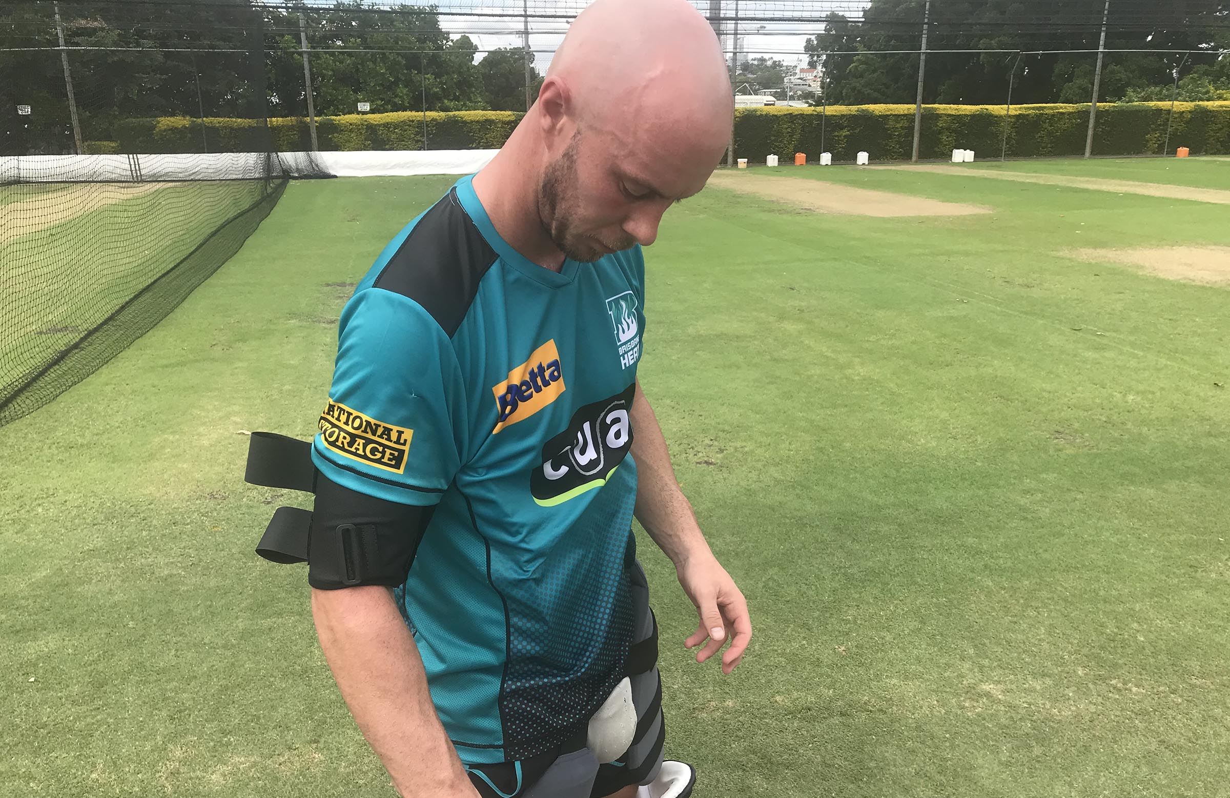 Lynn tests out his new strap in March // cricket.com.au
