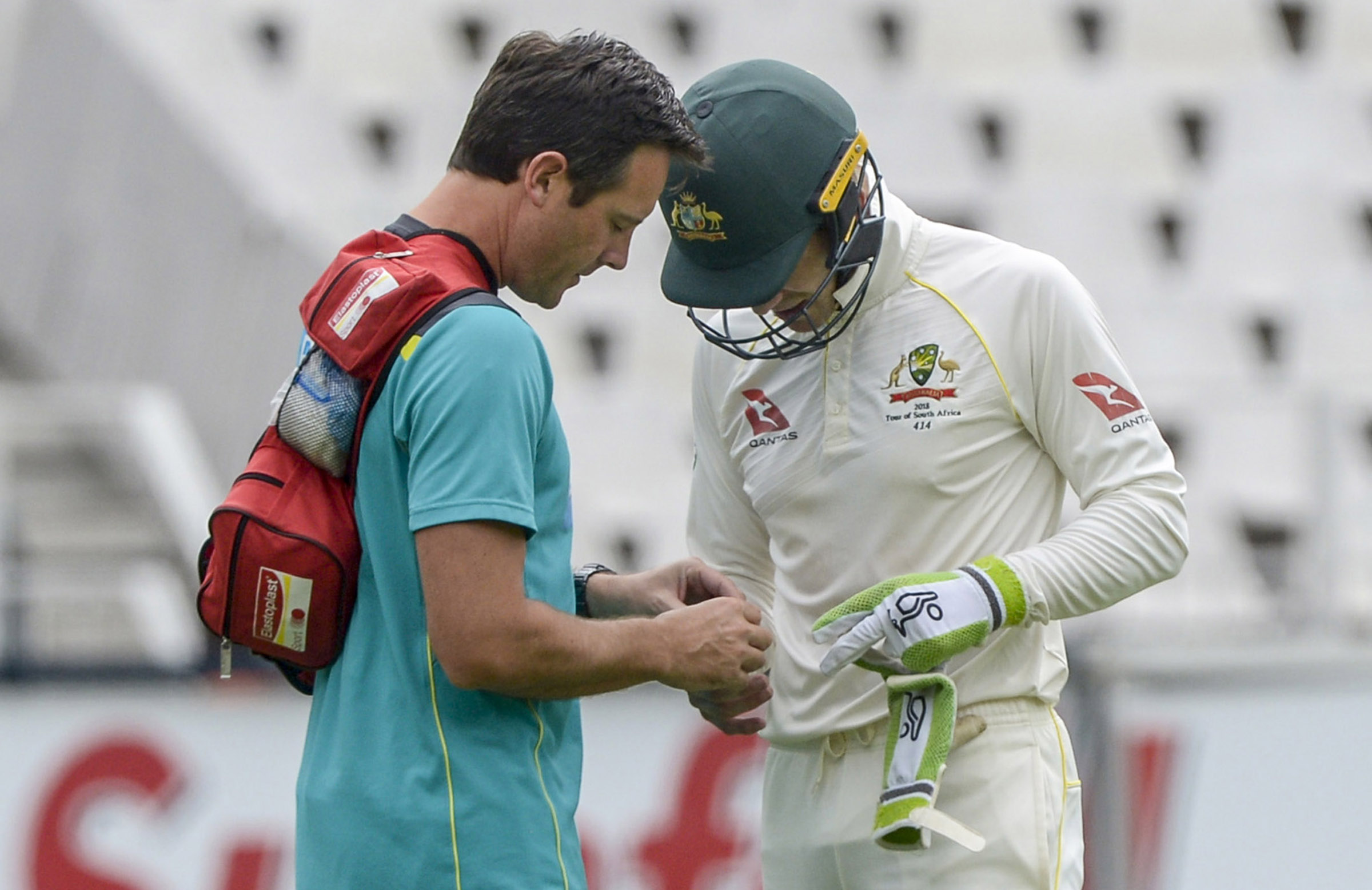 Paine receives treatment from Australia's medical staff // Getty