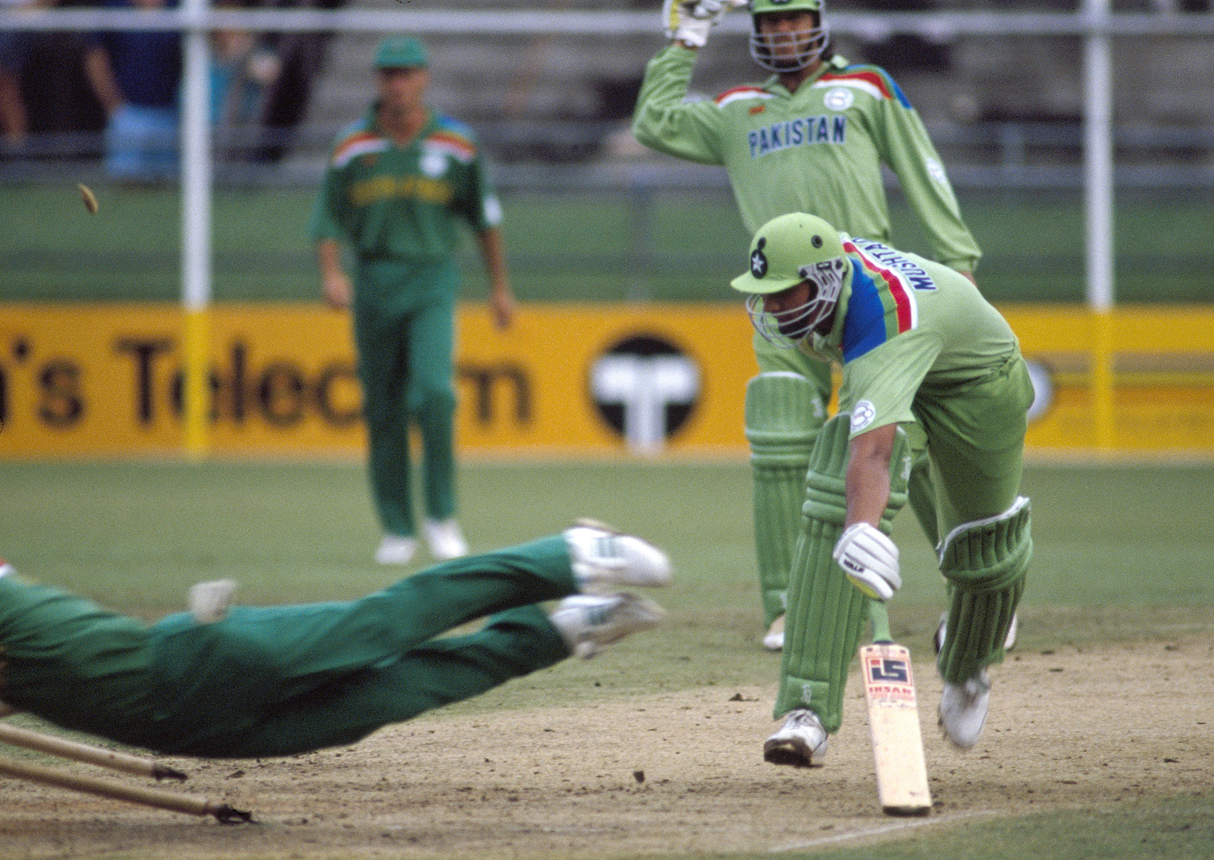 Rhodes clatters into the stumps to send Inzamam on his way // Getty