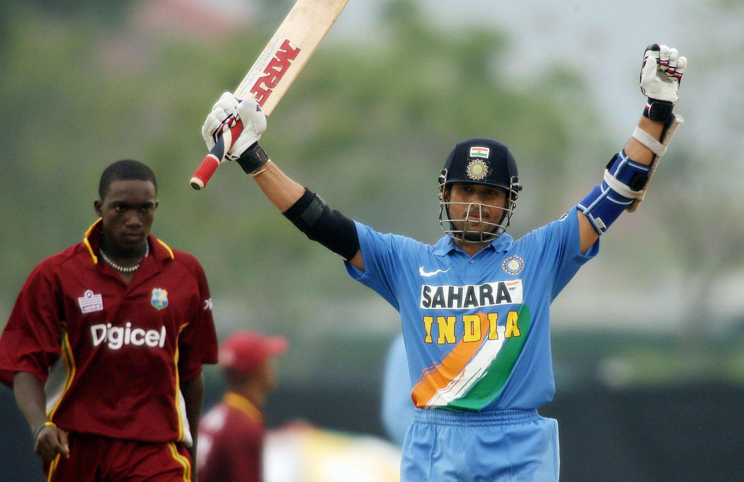 Sachin Tendulkar celebrates a hundred in the 2006 DLF Cup // Getty