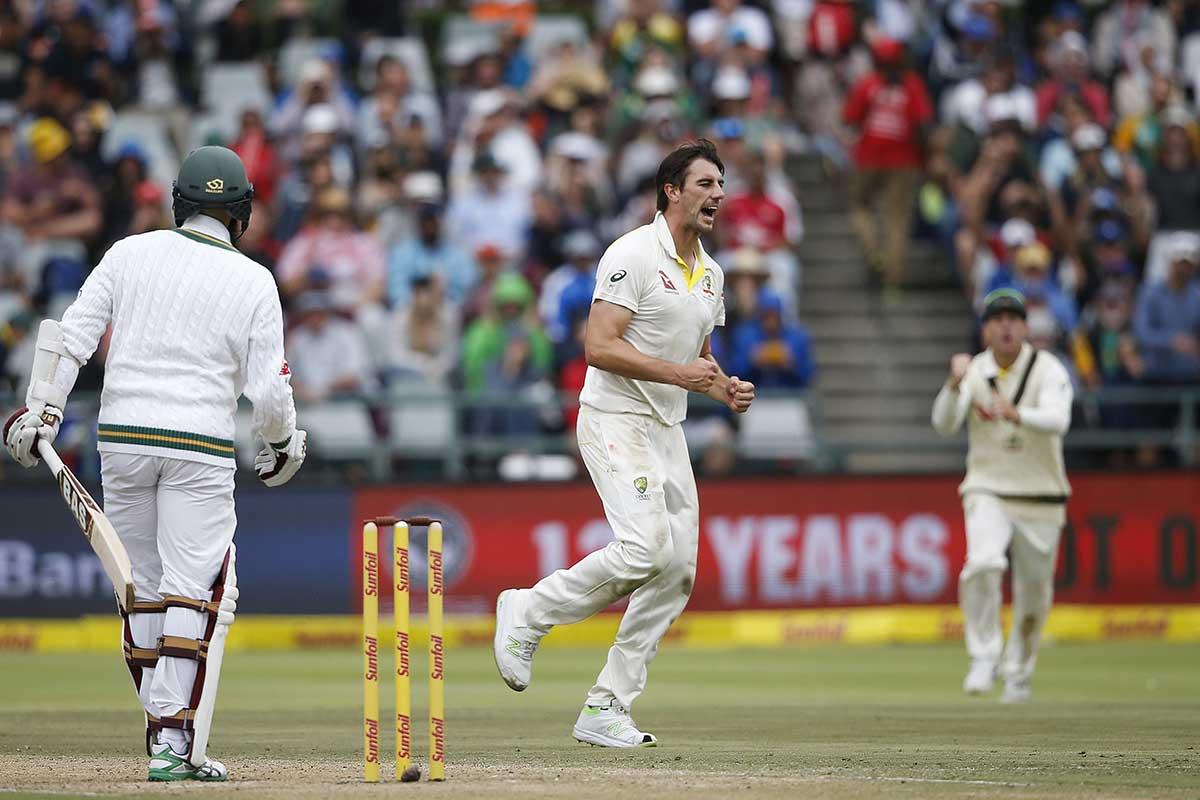 Cummins celebrates Amla's wicket // Getty