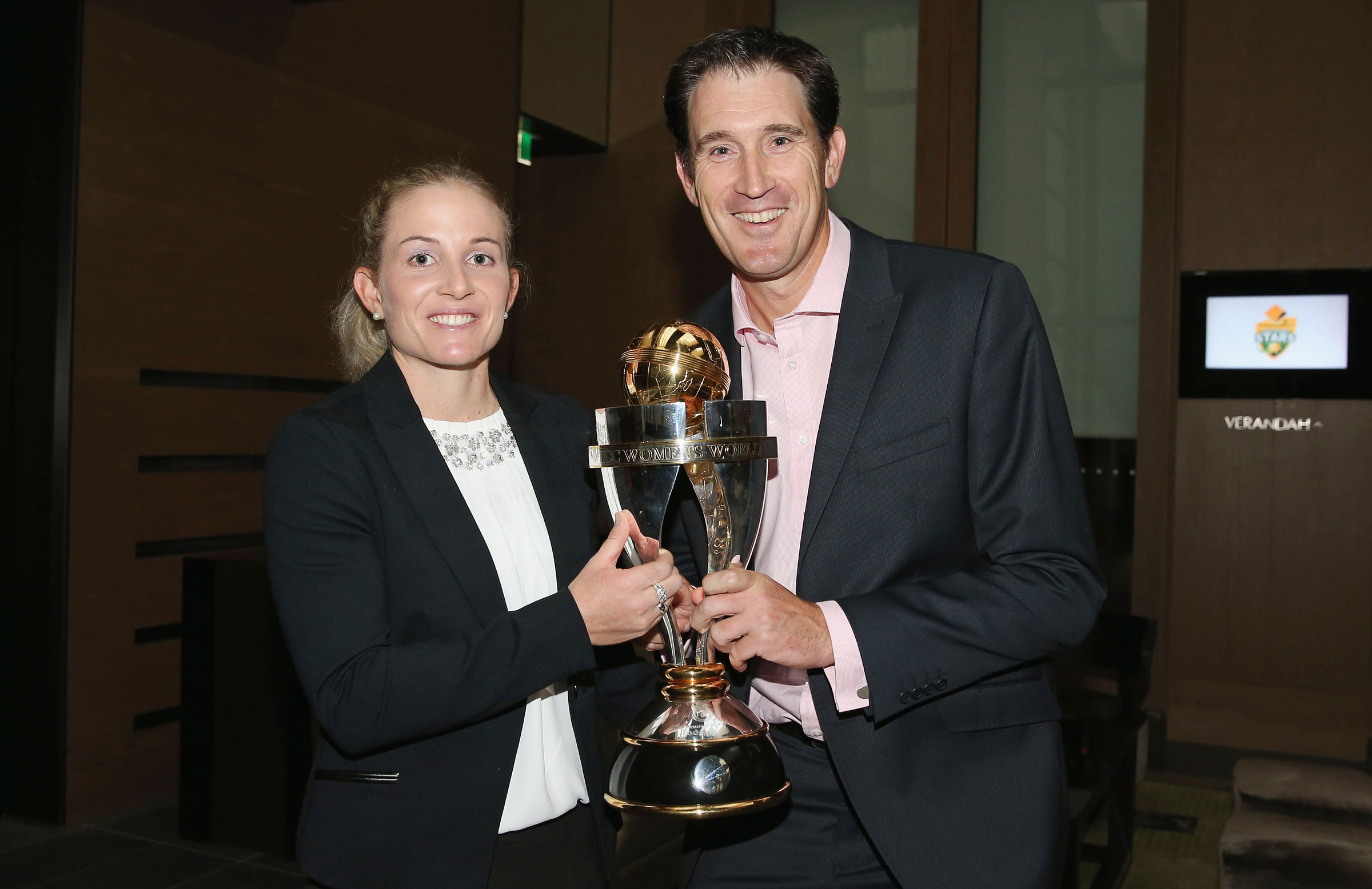 Sutherland with Jodie Fields following Australia's 2013 World Cup win // Getty