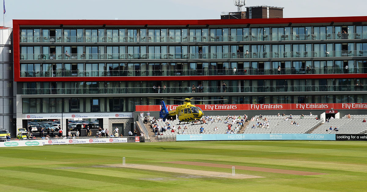 An Air Ambulance lands on the outfield at Old Trafford // Getty