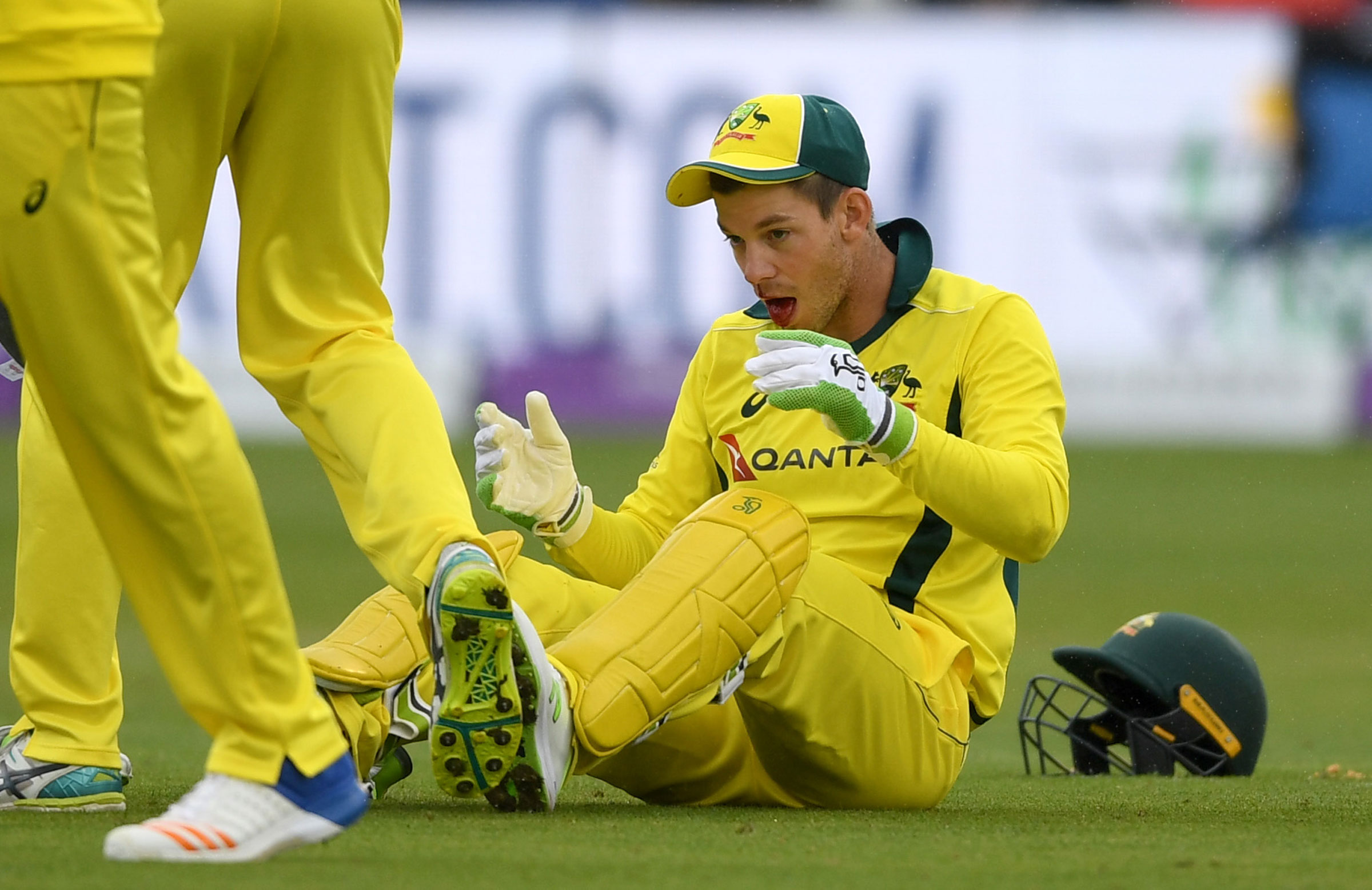 Tim Paine reacts after being hit in the face // Getty