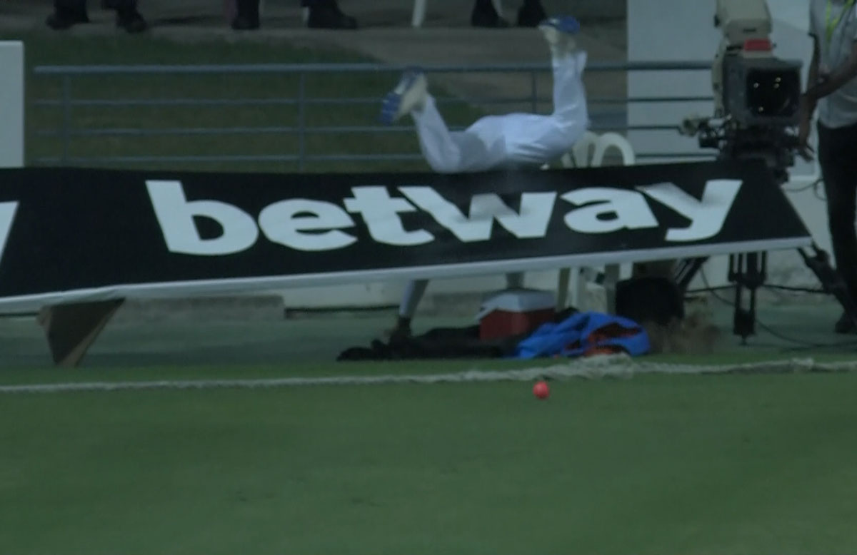 Perera ran into the advertising hoarding while fielding