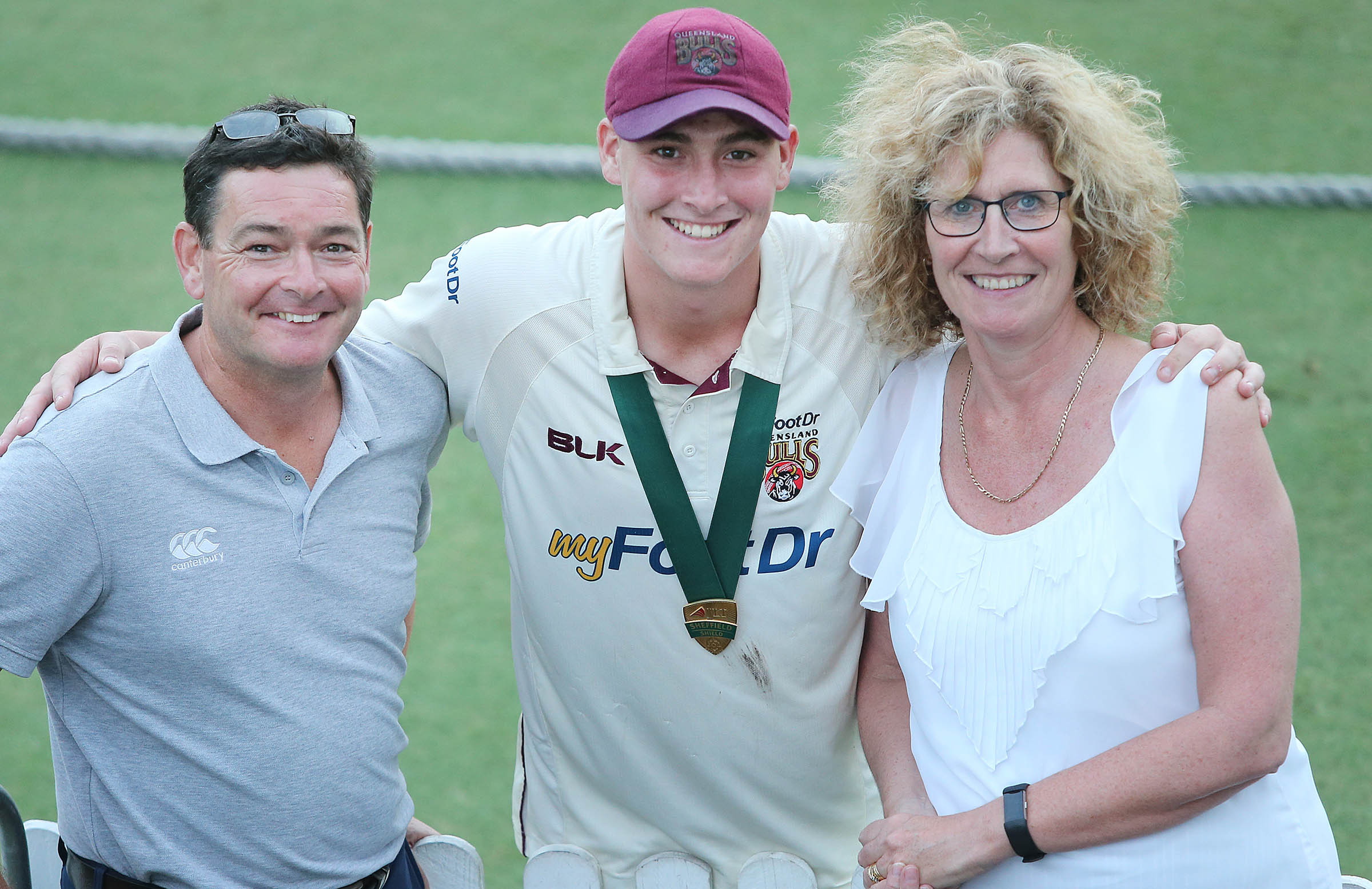 Renshaw with dad Ian and mum Alison // Getty