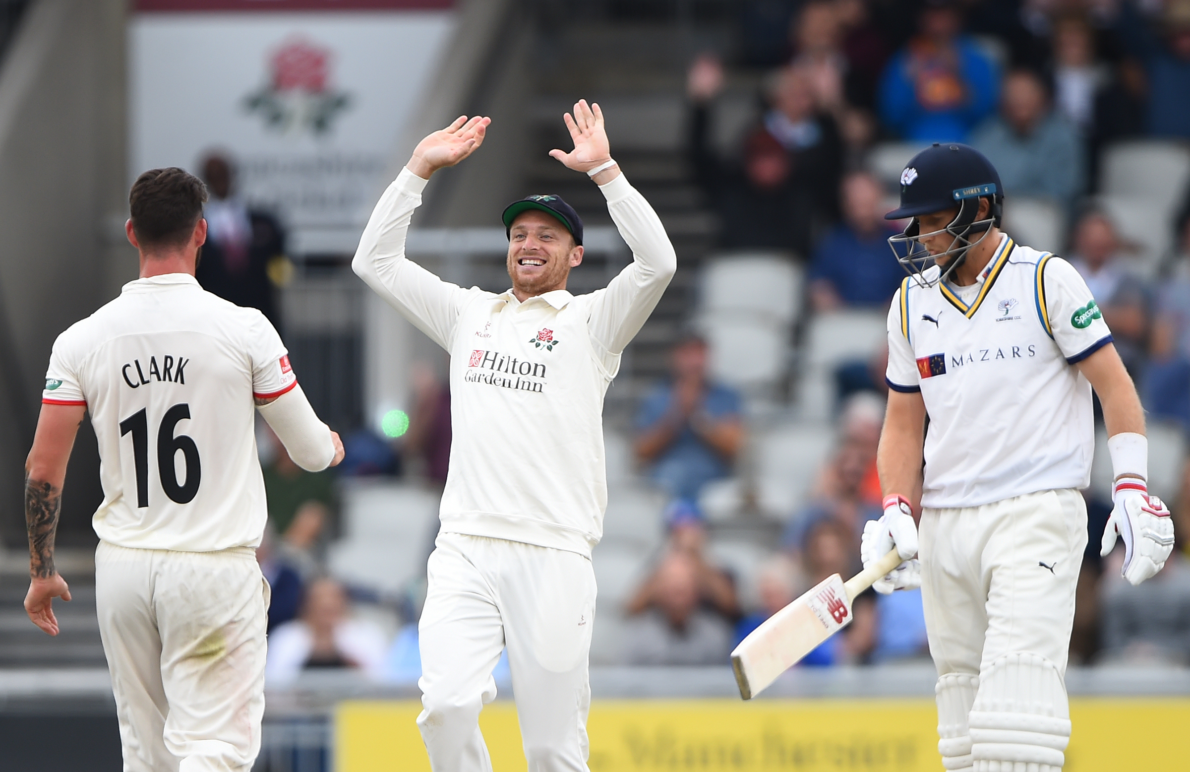Clark and Jos Buttler celebrate the wicket of Root // Getty