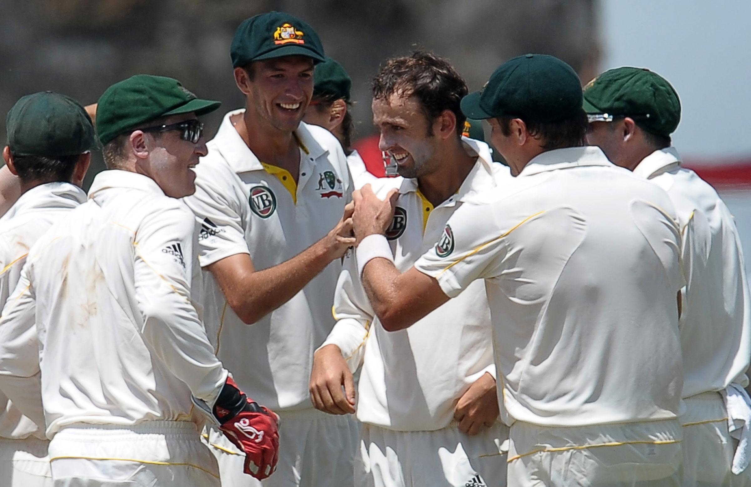 A young Nathan Lyon celebrates a wicket