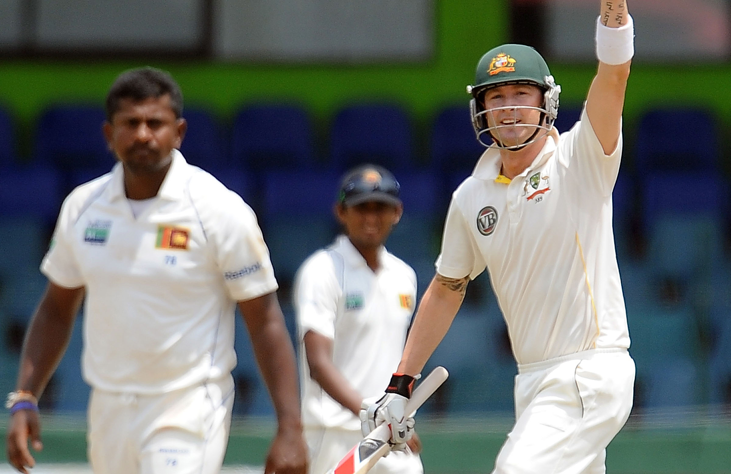 Michael Clarke celebrates his series-sealing draw in Colombo // Getty