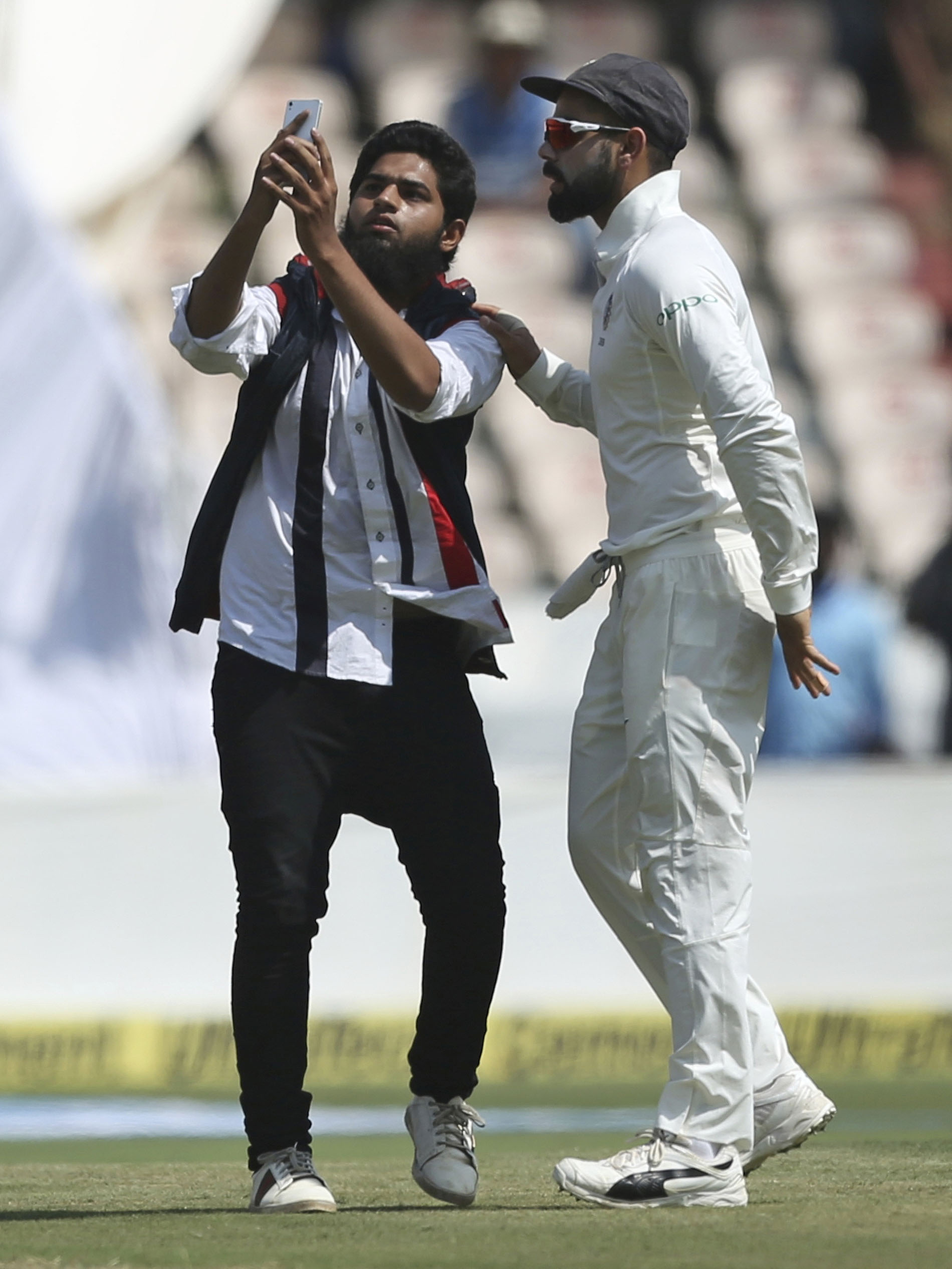 The fan attempts to take a precious selfie with Kohli // AAP