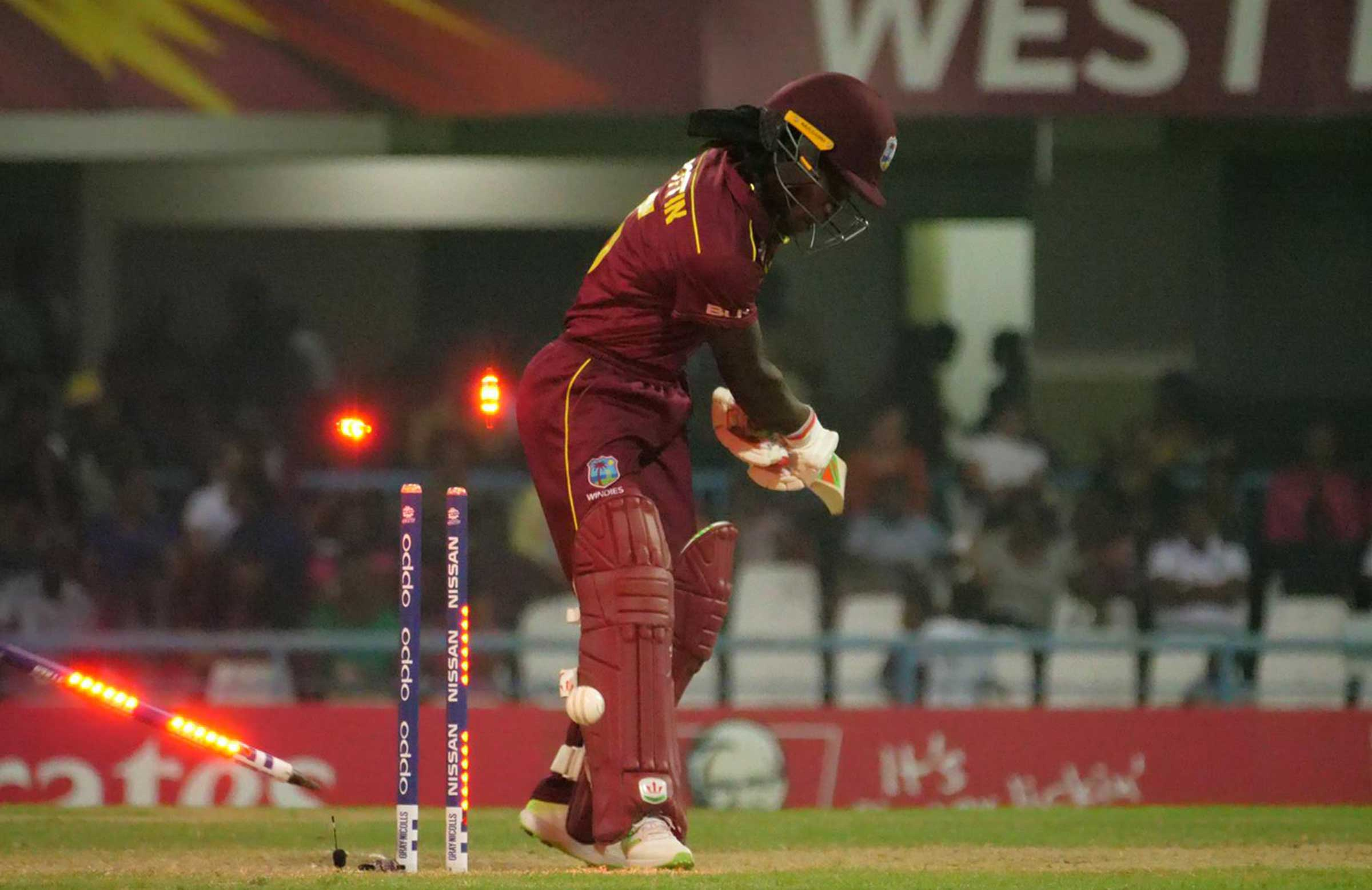Deandra Dottin is knocked over by Ellyse Perry // cricket.com.au