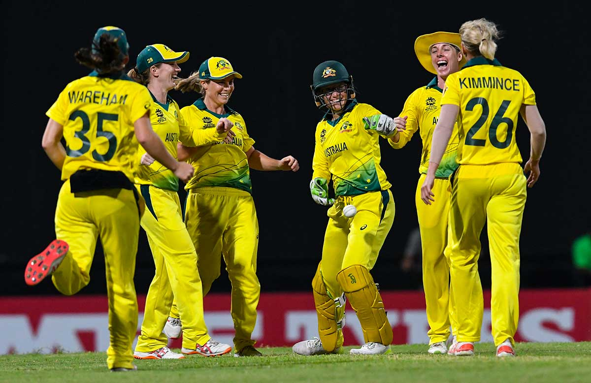 Healy celebrates her catch of a high ball // Getty