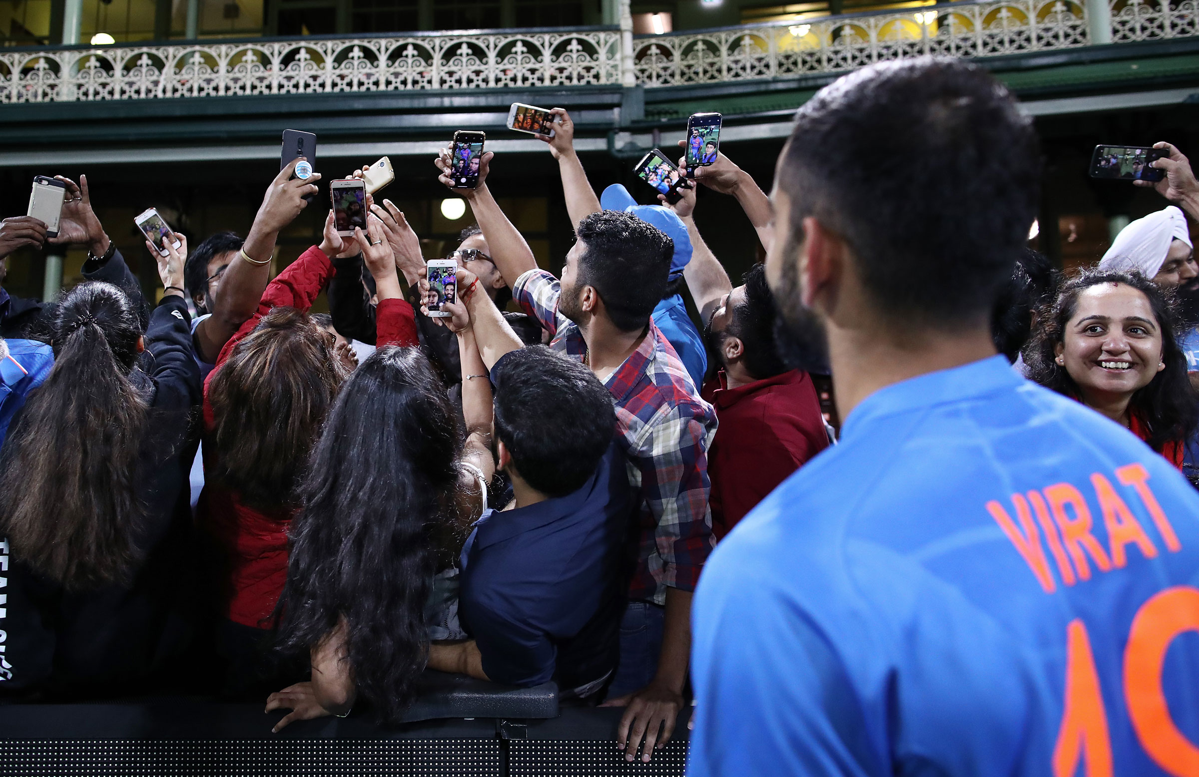 Kohli poses for selfies with fans in Australia // Getty Images
