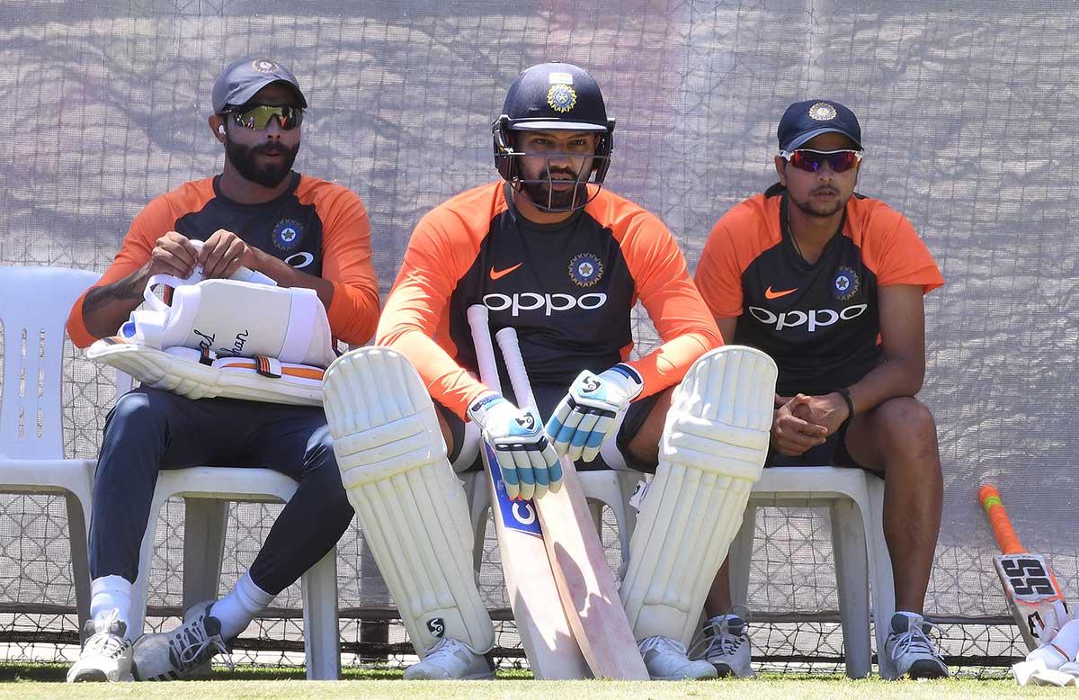 Rohit Sharma (centre) won the nod to bat at No.6 // AAP