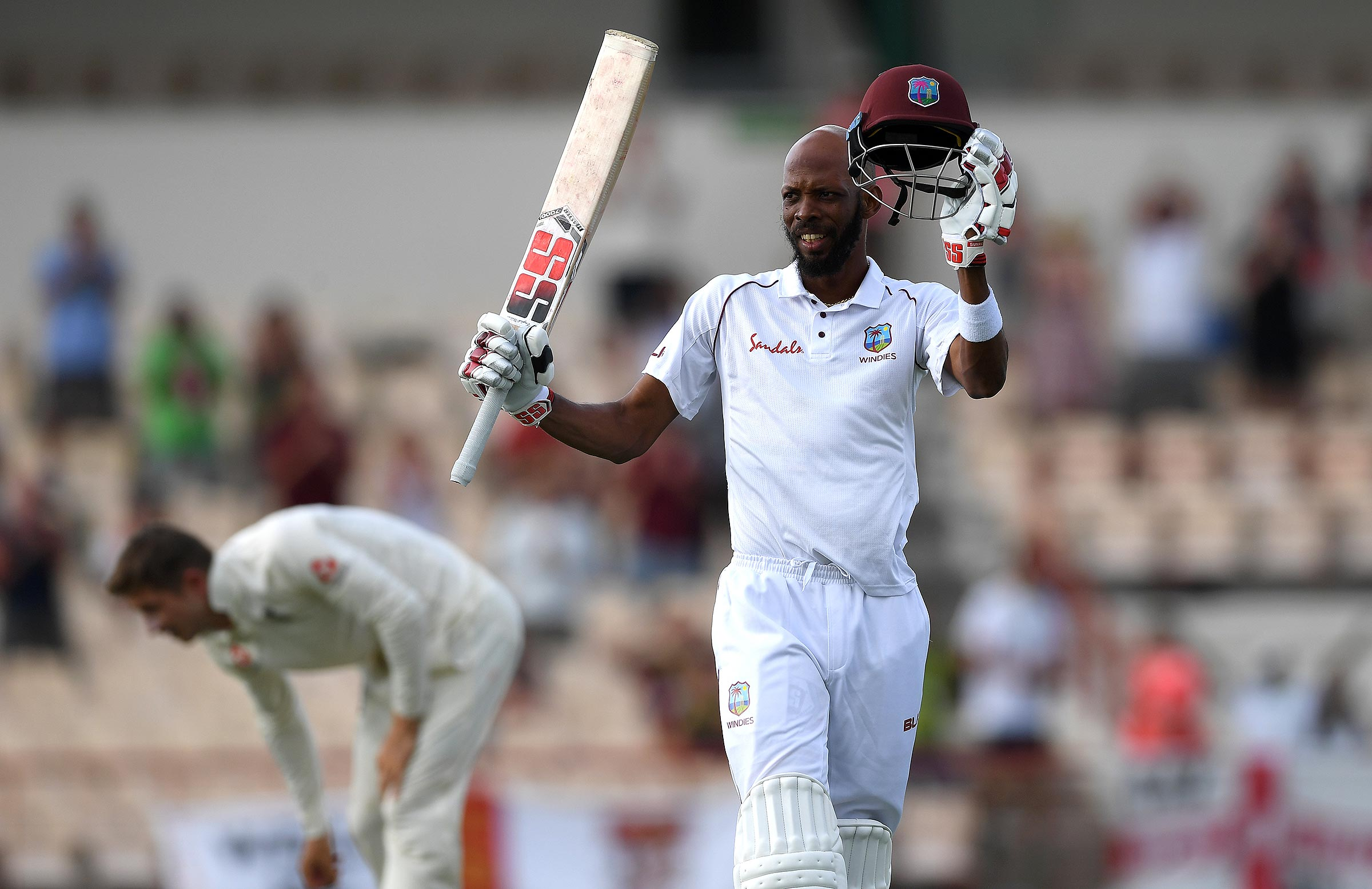 Chase celebrates his century late in the match // Getty