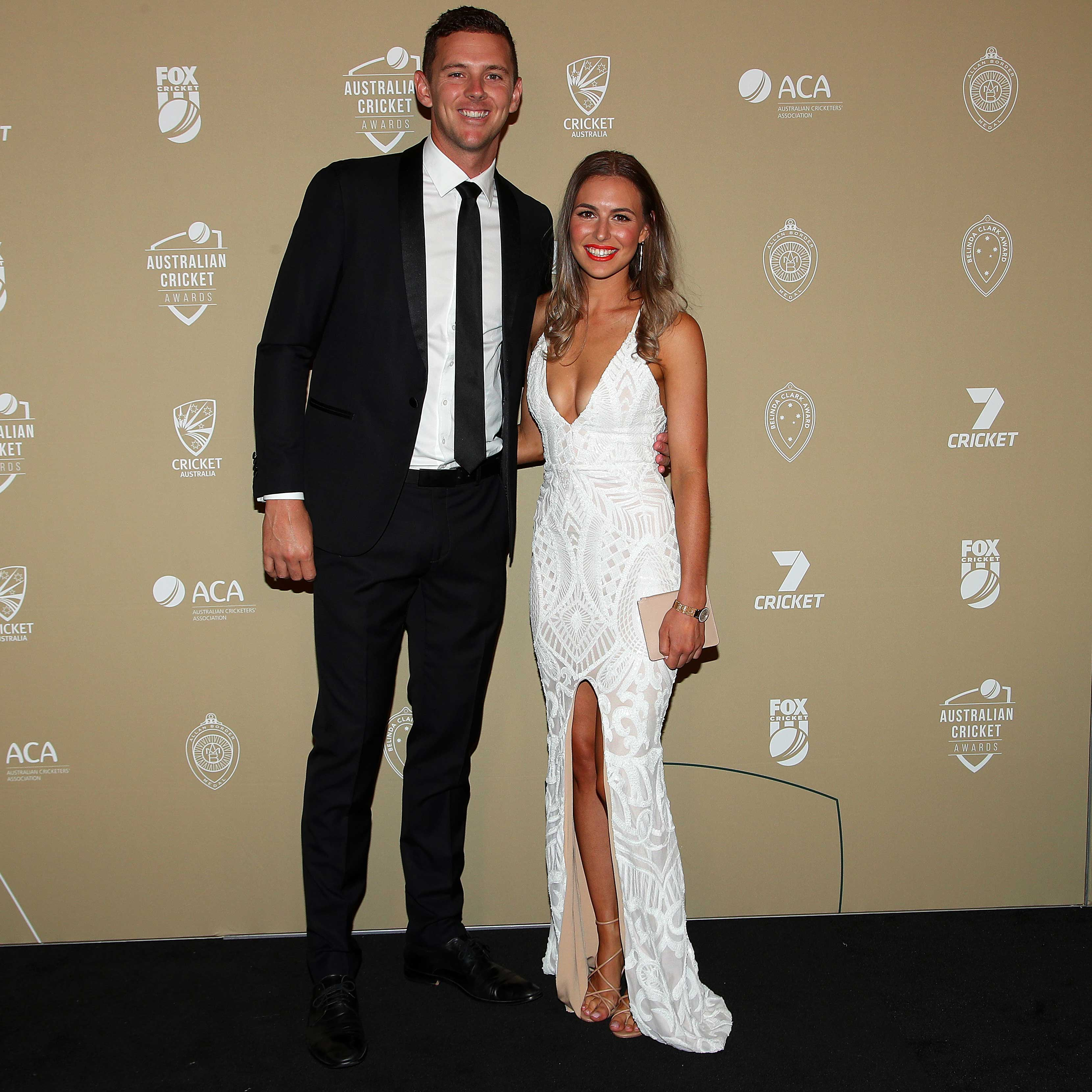 Josh Hazlewood and Cherie Christian // Getty