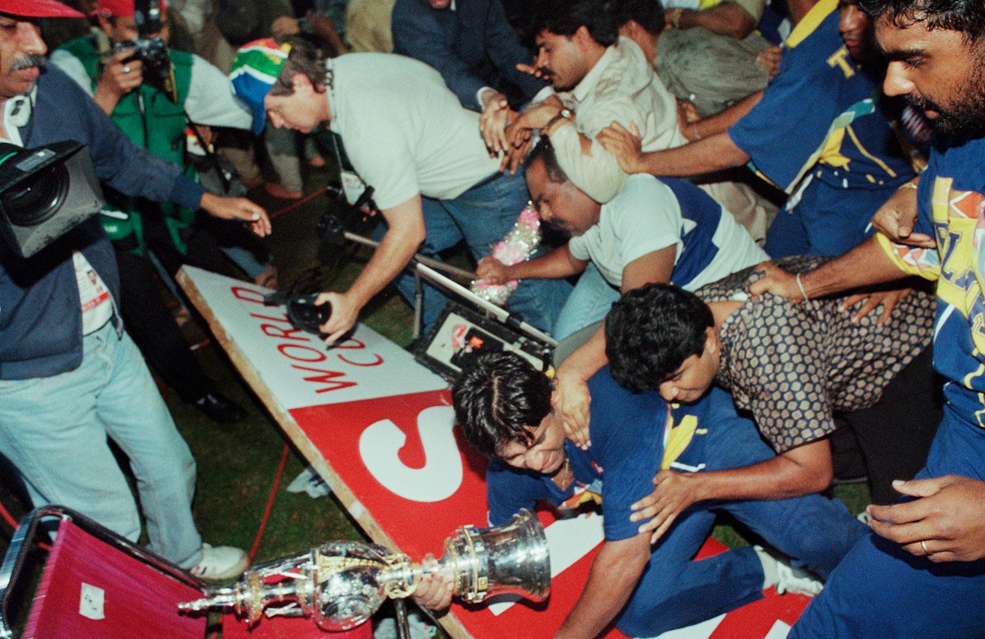 Arjuna Ranatunga clutching the World Cup trophy // Trent Parke / Magnum Photos