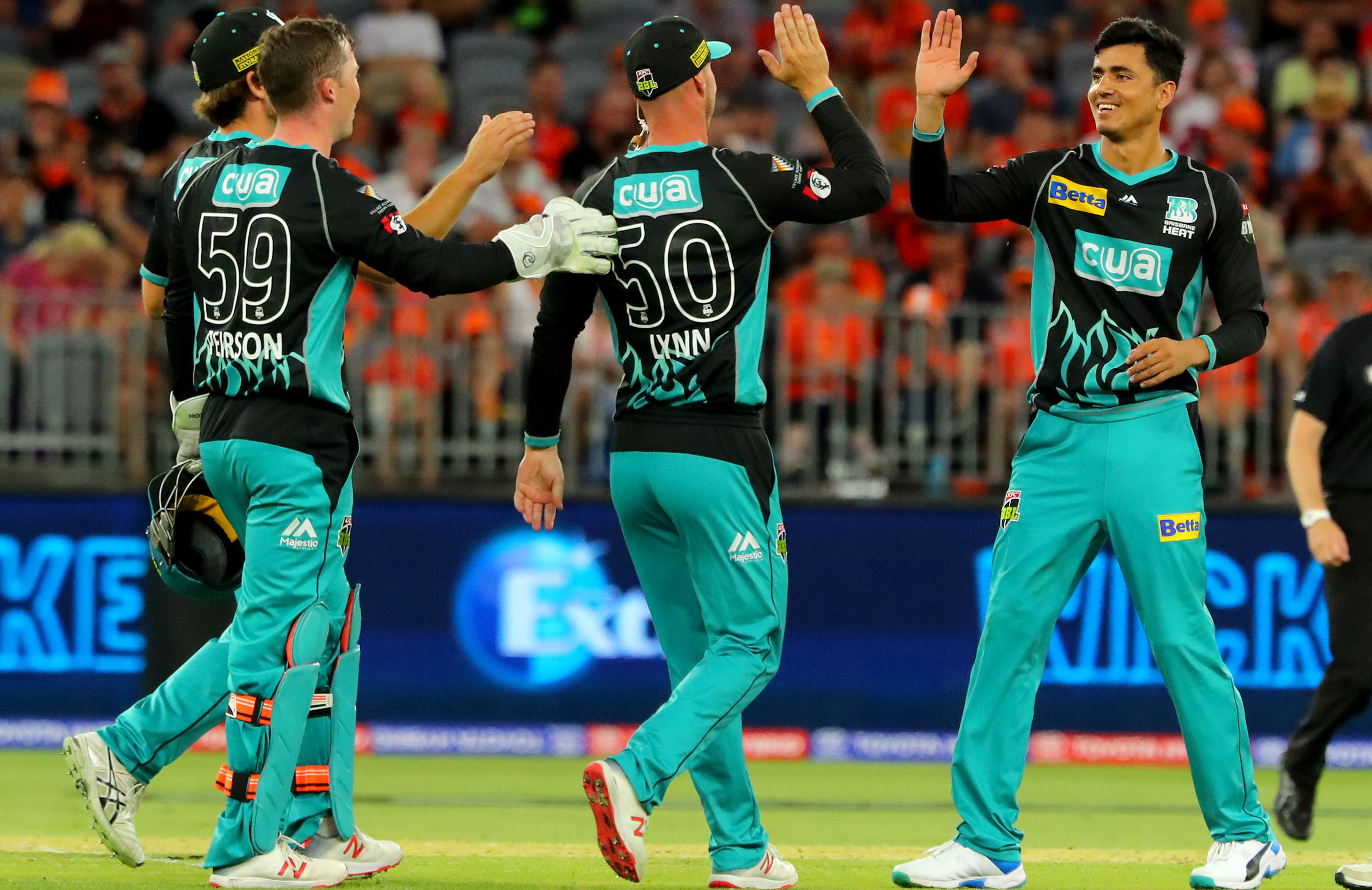 Mujeeb celebrates a wicket in his rookie season with the Heat // Getty