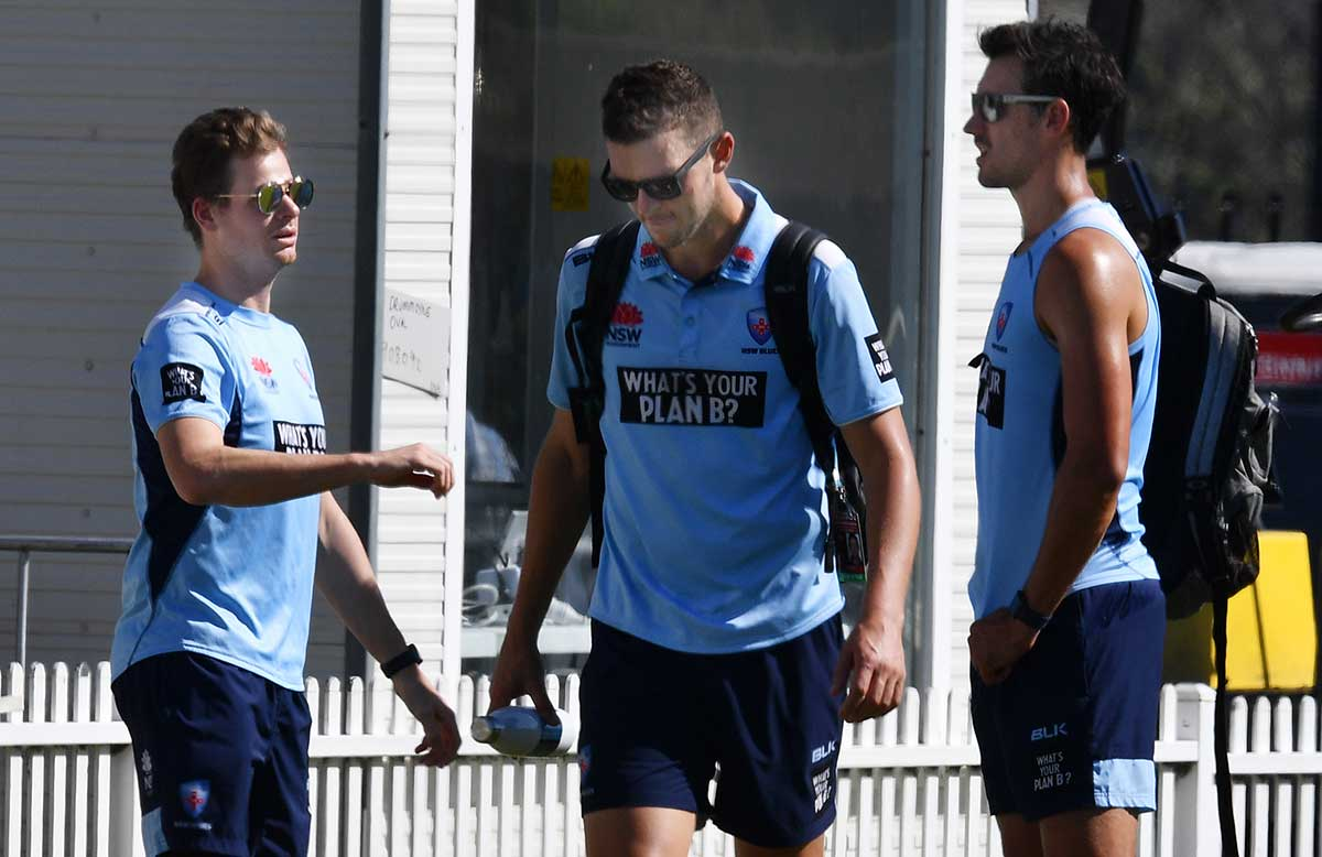 Smith, Hazlewood and Starc at the NSW v Victoria game // AAP
