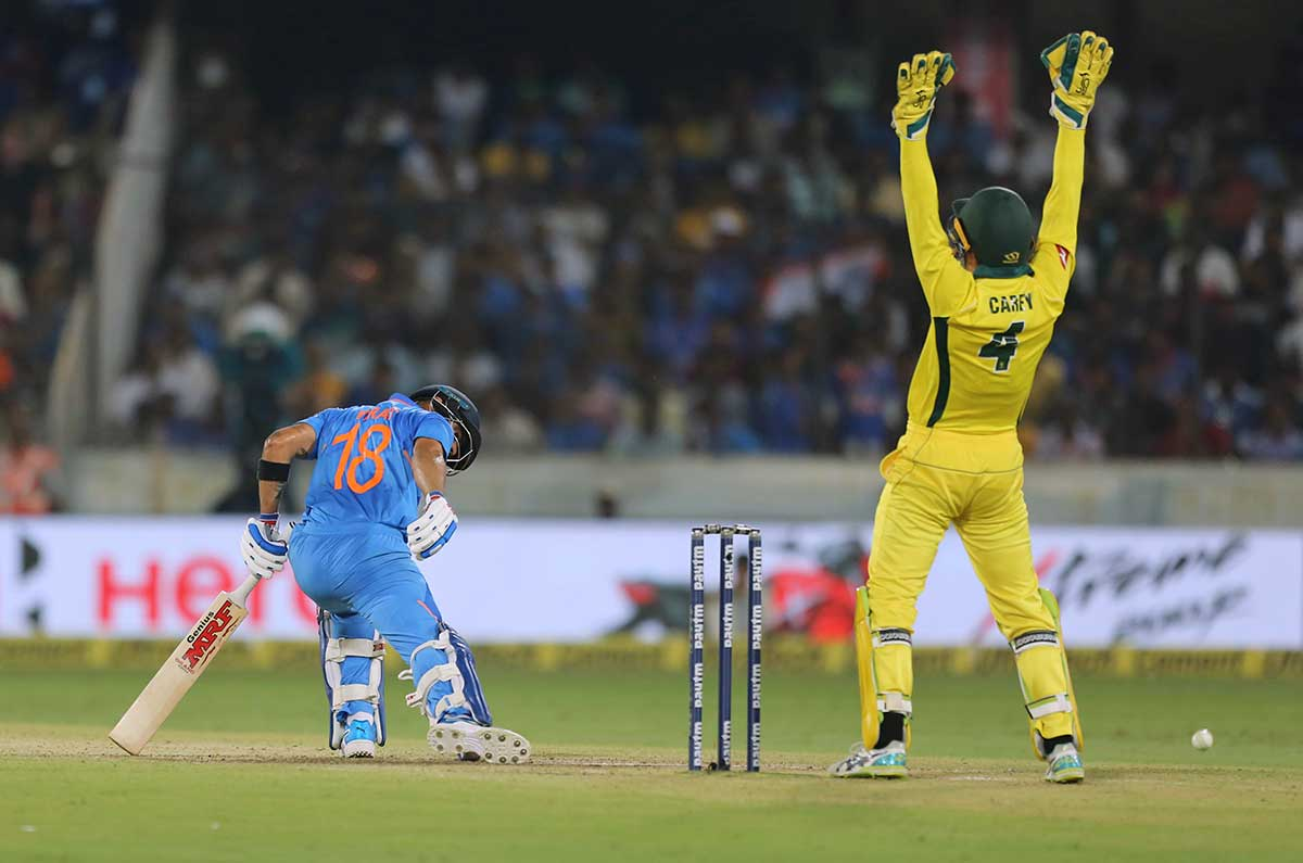 Kohli falls LBW to Zampa in Bengaluru // Getty