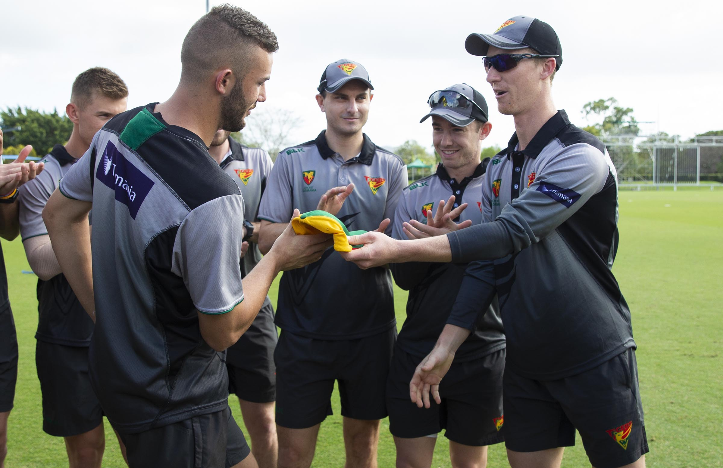 Presenting Aaron Summers with his Tasmania one-day cap // AAP