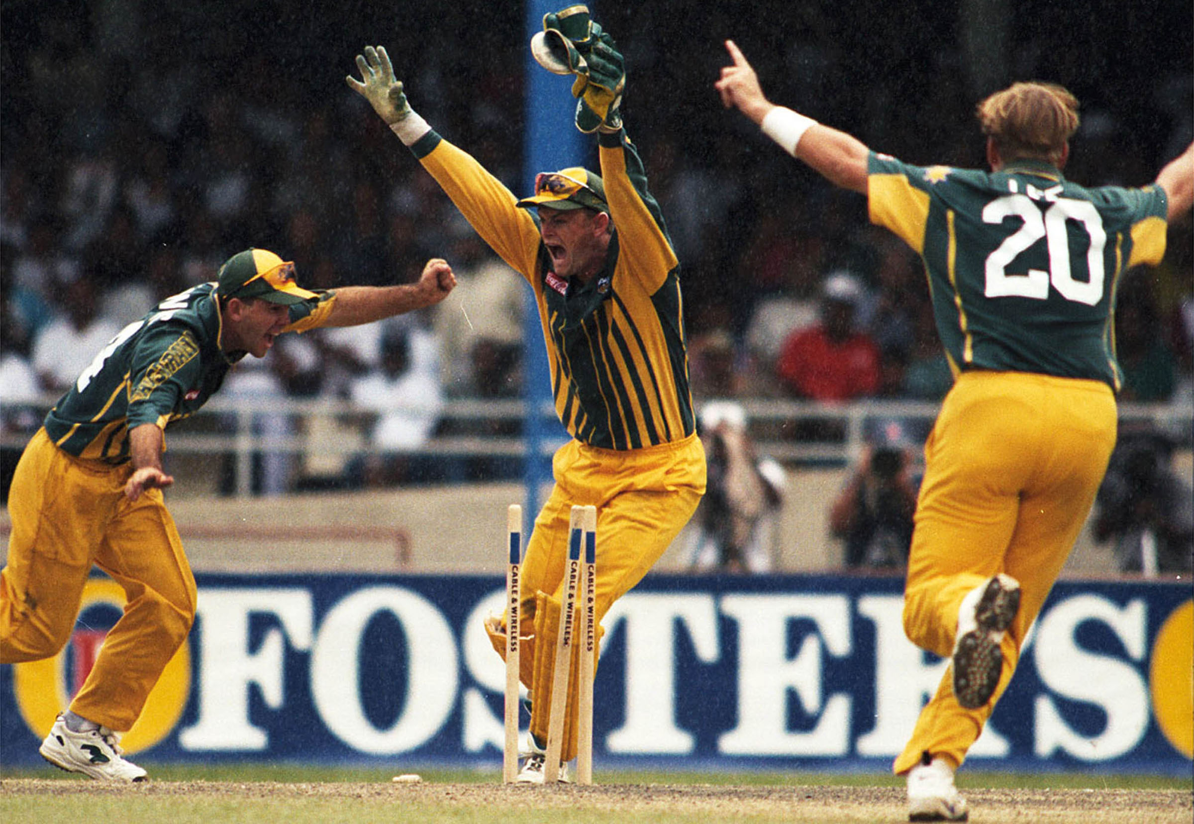 (L-R) Ricky Ponting, Adam Gilchrist and Shane Lee celebrate a wicket // Getty