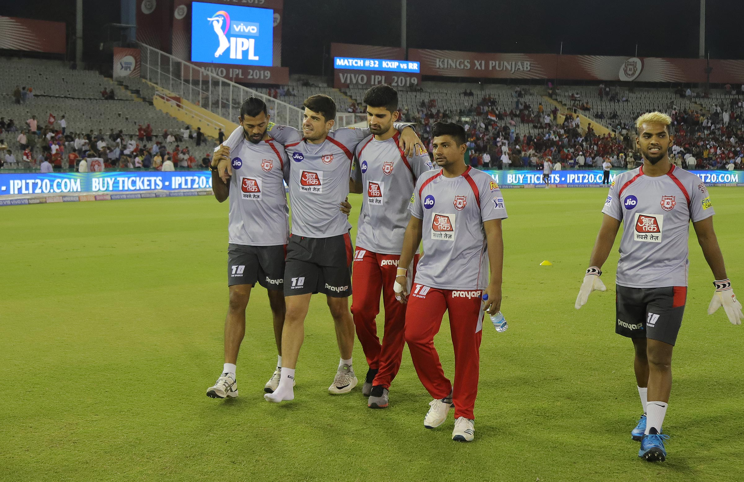 Henriques hobbles off the ground before play // BCCI
