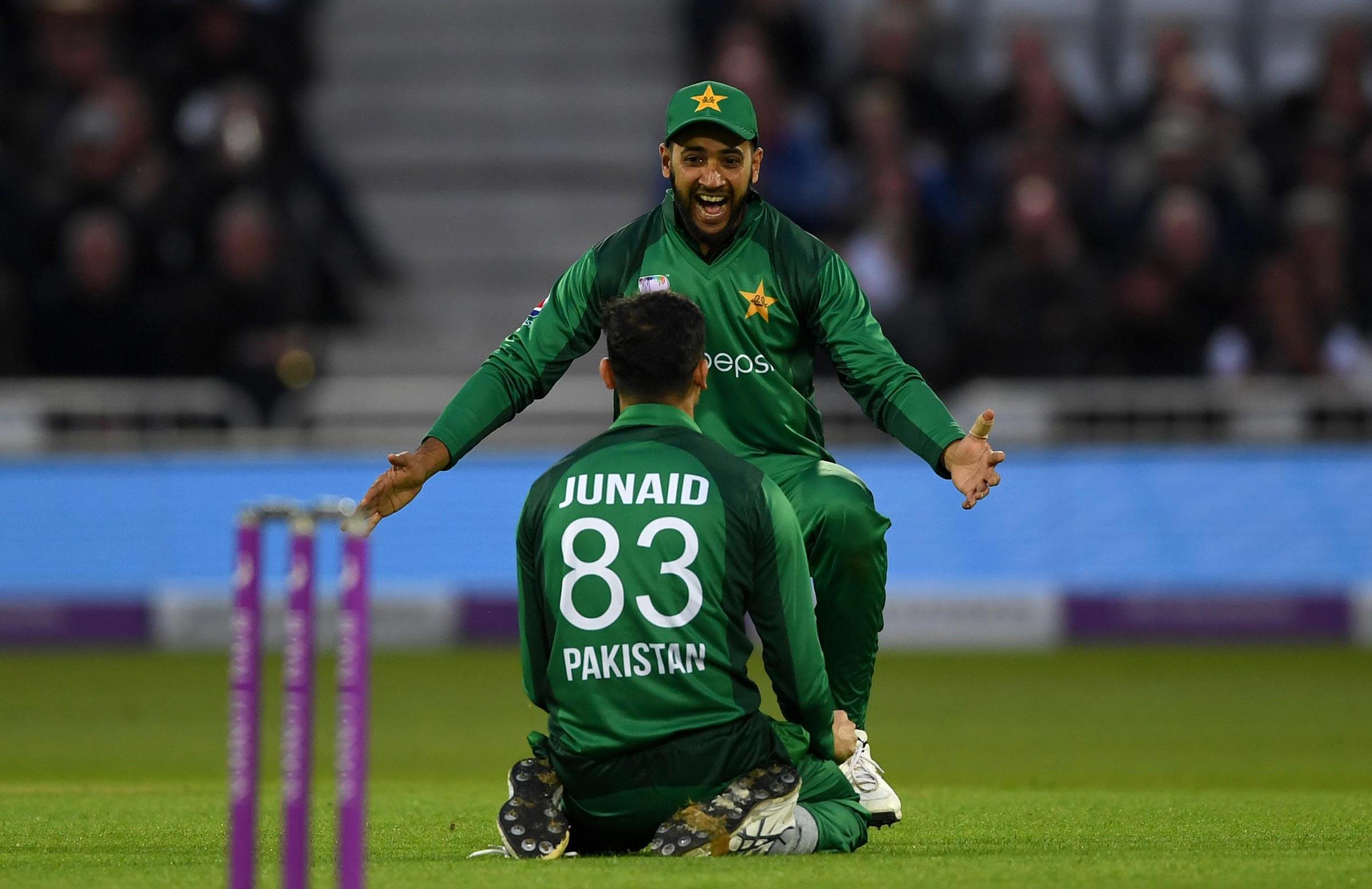 Junaid is swamped after dismissing Denly // Getty