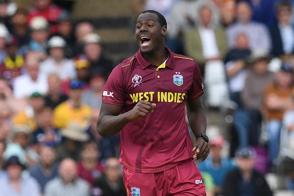 Carlos Brathwaite celebrates a wicket against the Australians // Getty