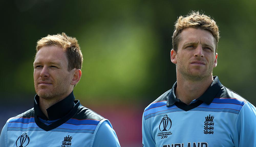 Jos Buttler stands aside England captain Eoin Morgan during an earlier World Cup clash // Getty