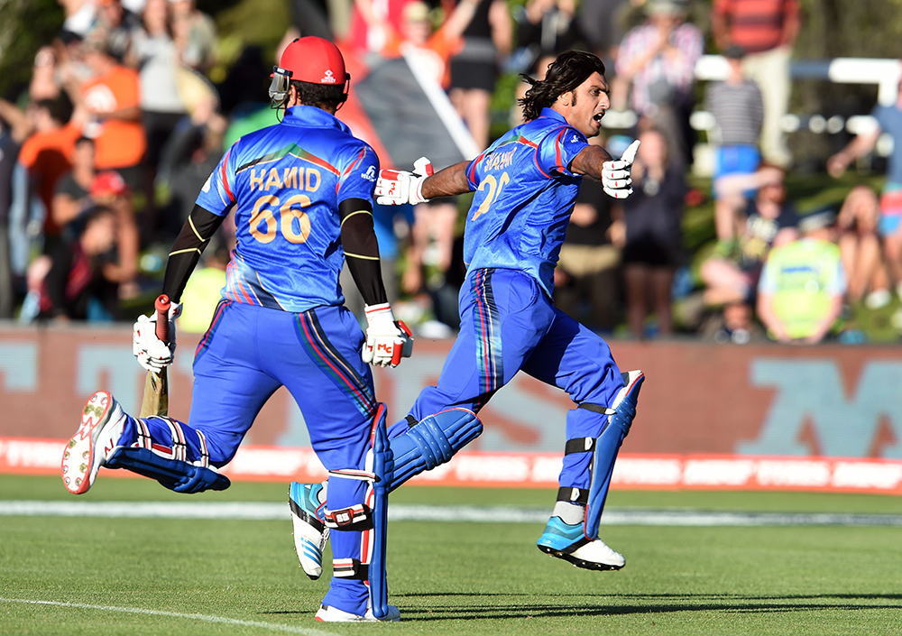 Afghanistan celebrate their most recent World Cup win - over Scotland in 2015 // Getty
