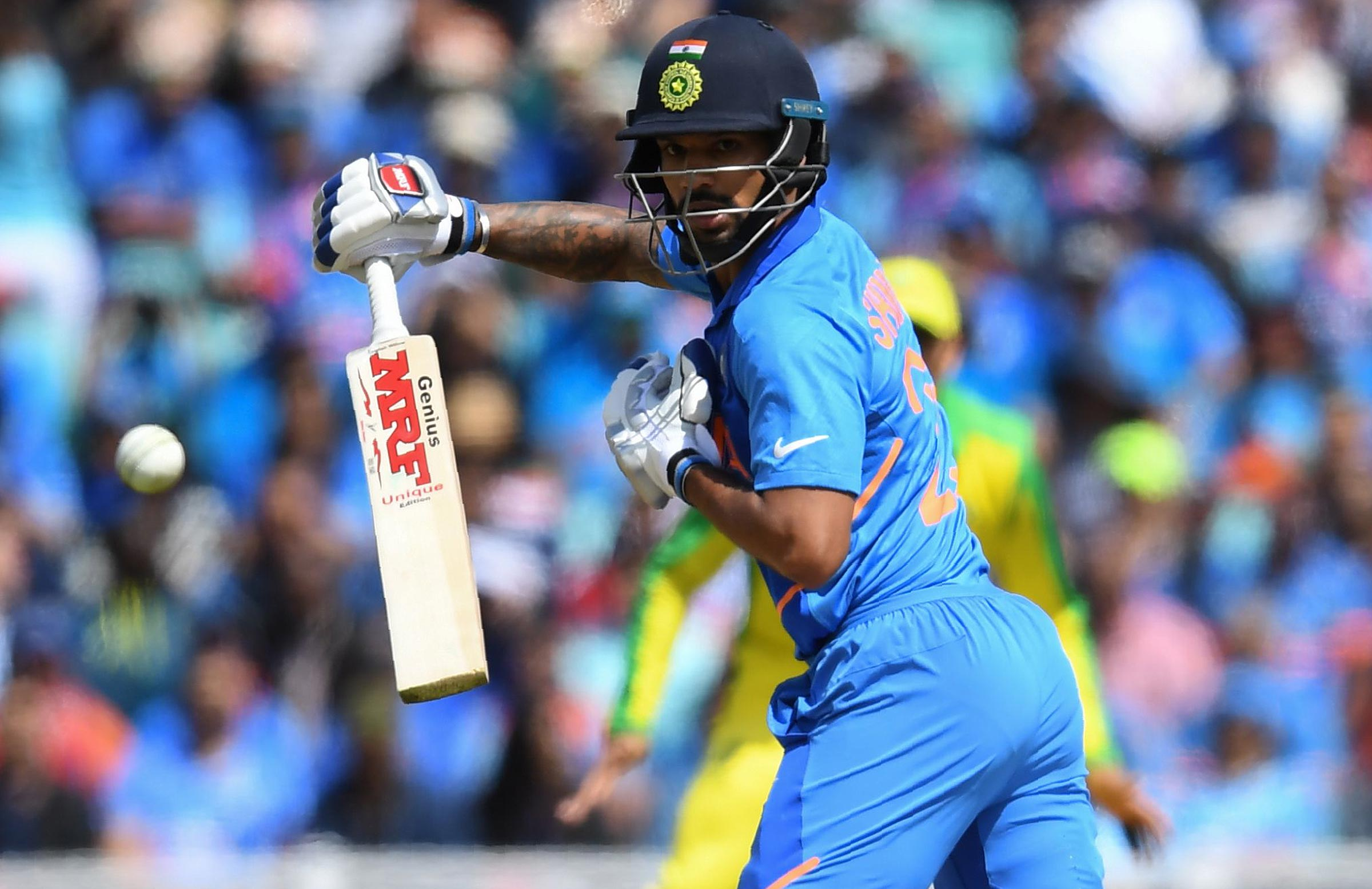Dhawan removed his hand from the bat at The Oval // Getty