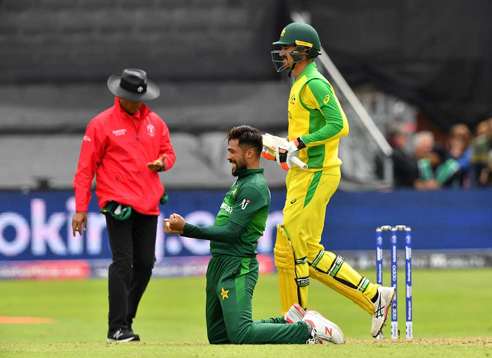 Amir celebrates Starc's wicket for his fifth // Getty