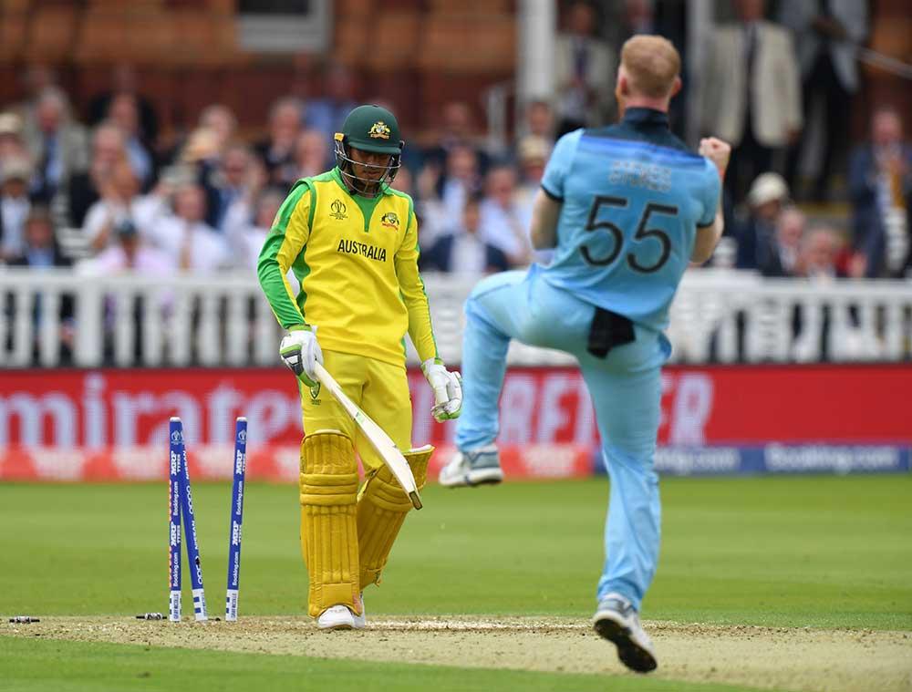 Ben Stokes knocks over Usman Khawaja // Getty