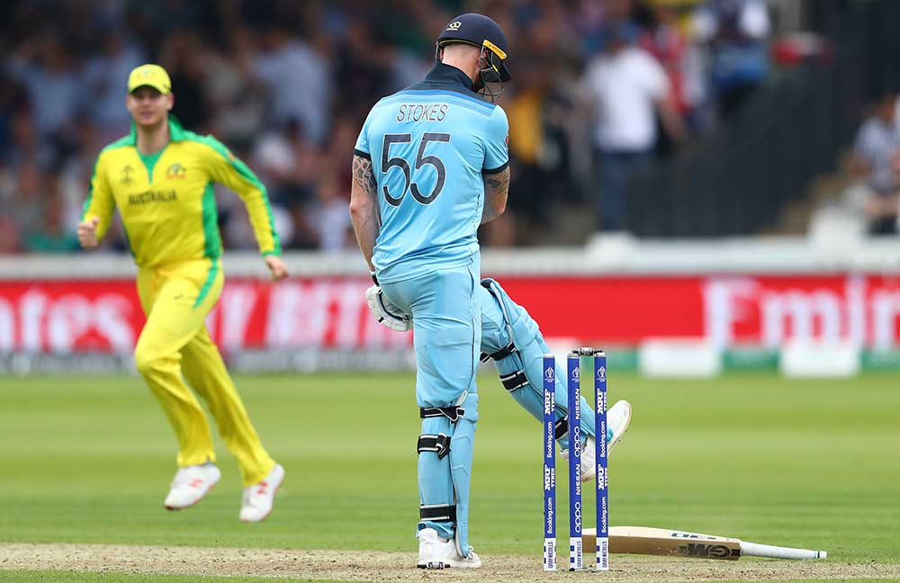 Stokes kicks his bat away after being bowled // Getty