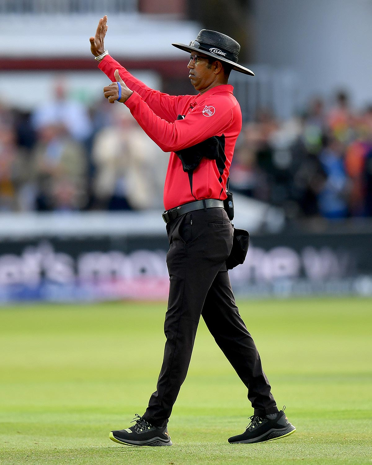 Umpire Dharmasena adds six runs to the total // Getty