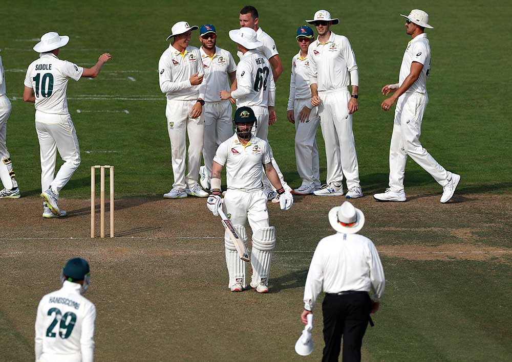 Matthew Wade chats with the umpire after his dismissal // Getty