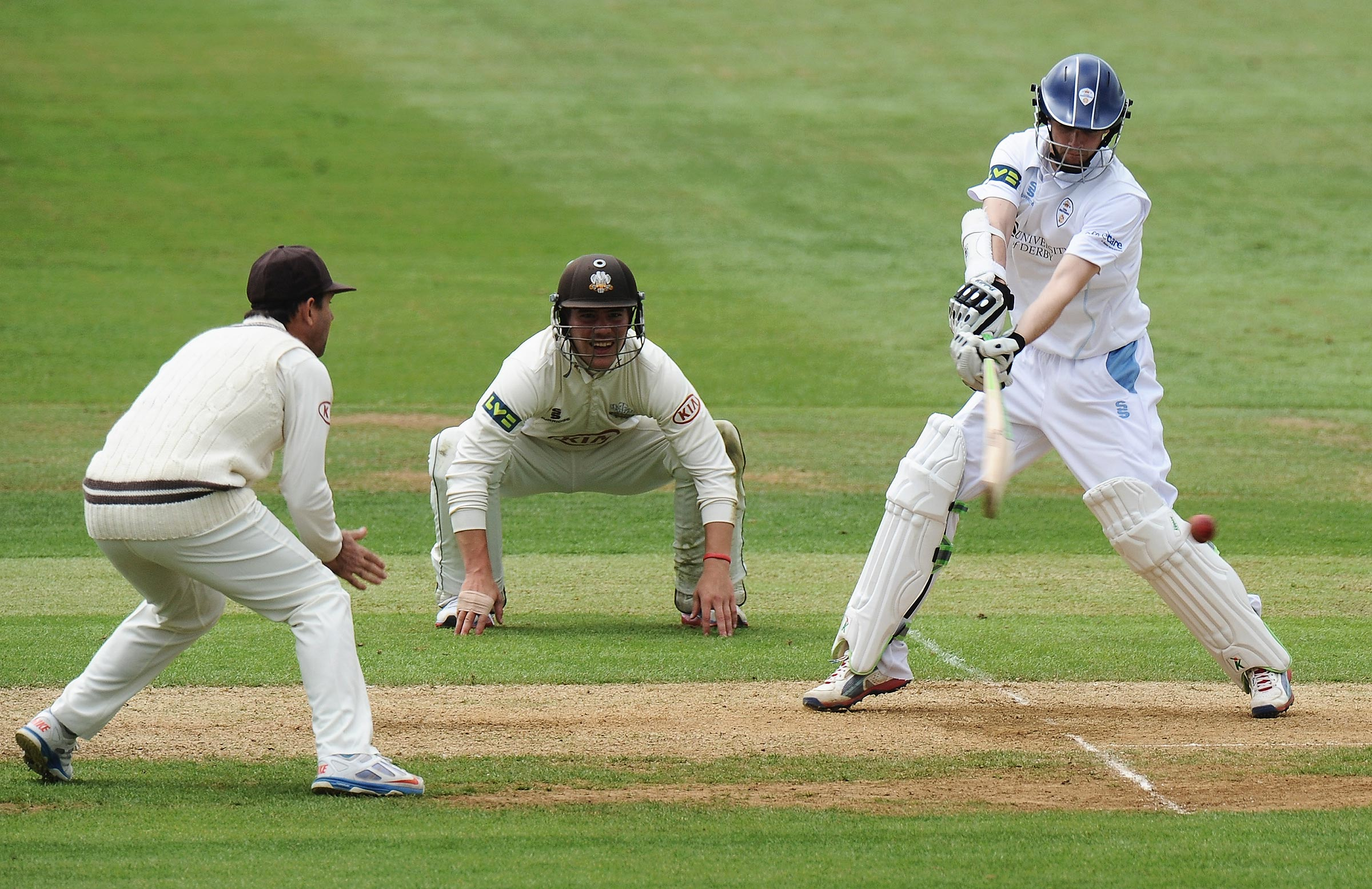 Ponting (left) and Burns (centre) during a game for Surrey in 2013 // Getty