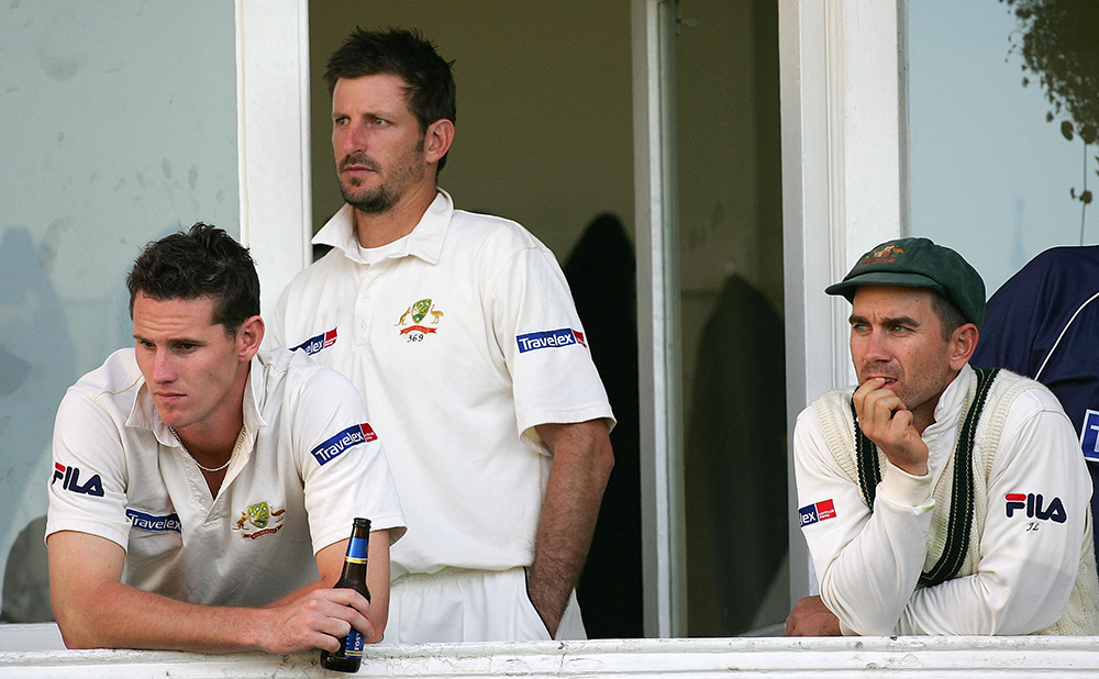 Kasprowicz alongside Shaun Tait (left) and Justin Langer (right) after an unsuccessful Ashes Test in 2005 // Getty
