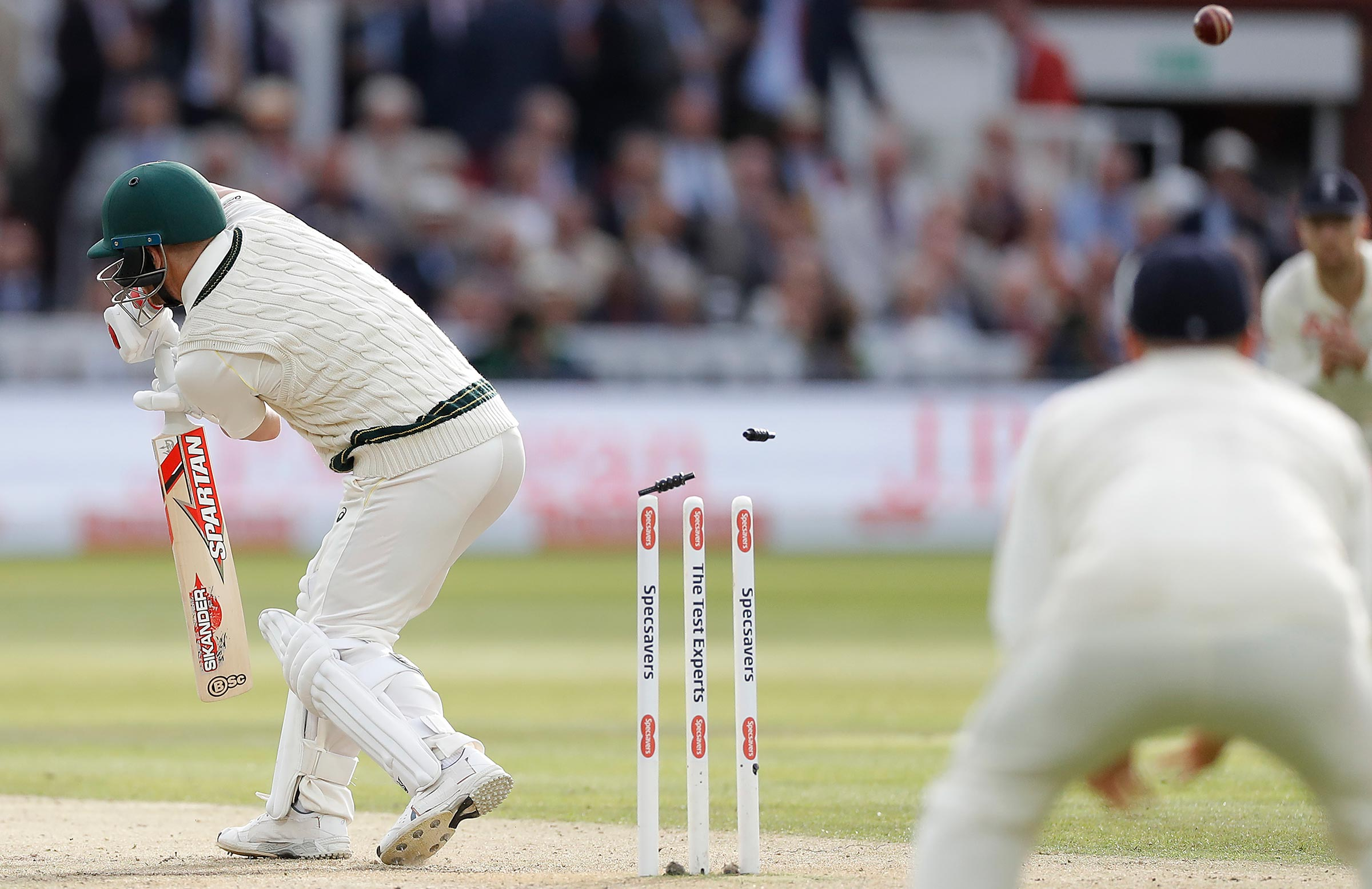 Warner is bowled late on day two at Lord's