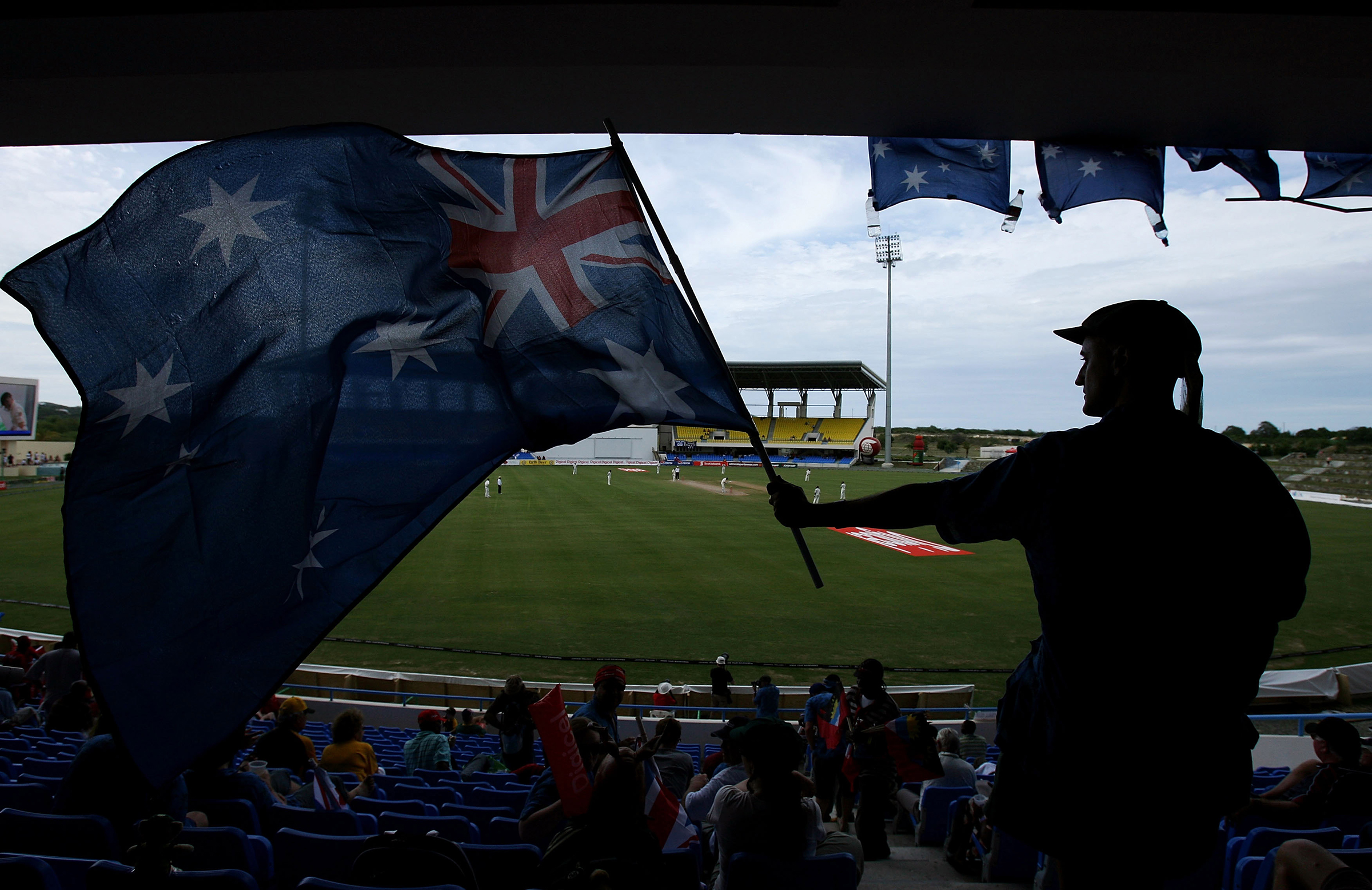 Gillian waves the flag at a 2008 Test in Antigua // Getty