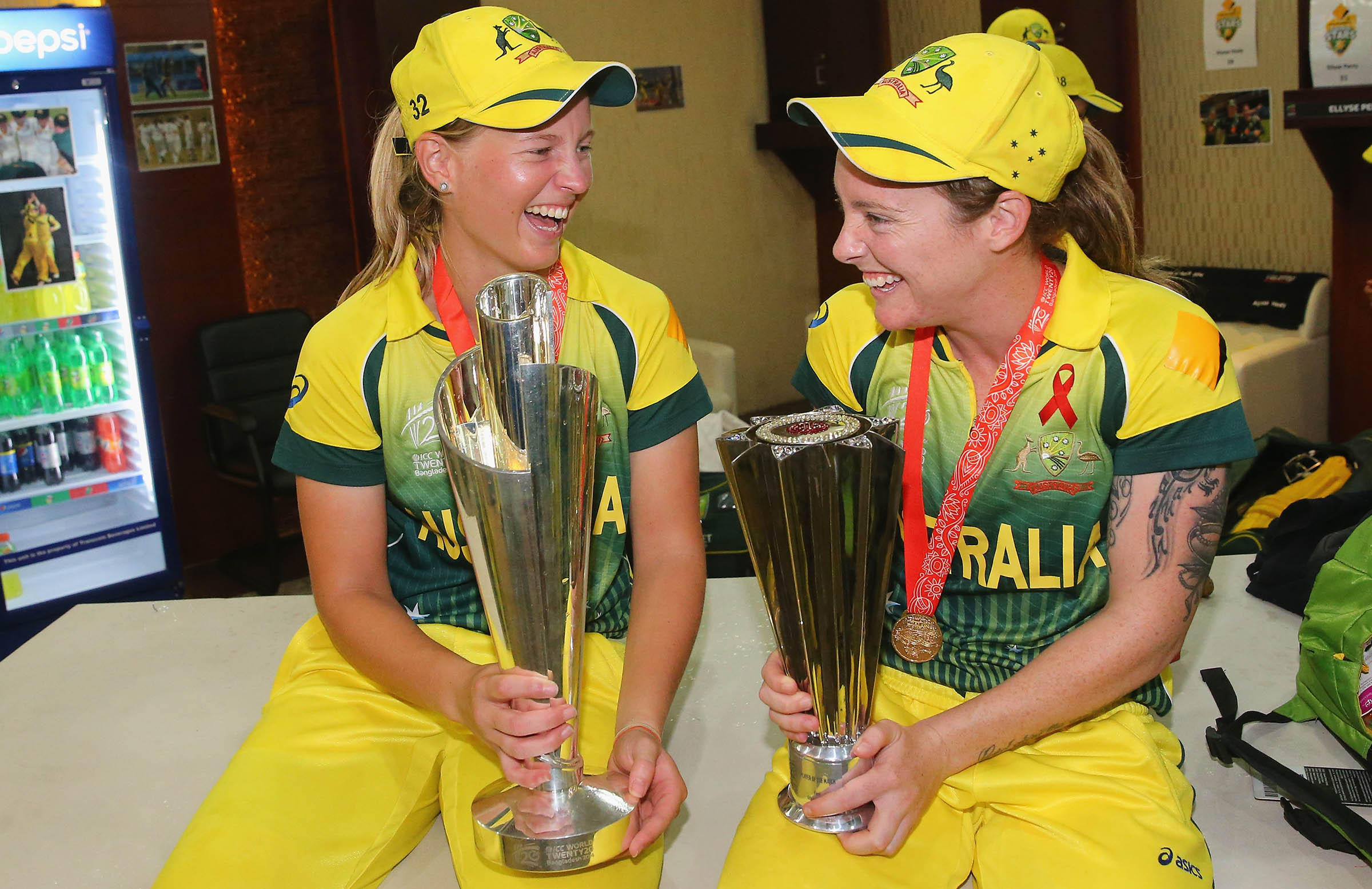 Sharing the spoils of a World T20 triumph with Meg Lanning in 2014 // Getty