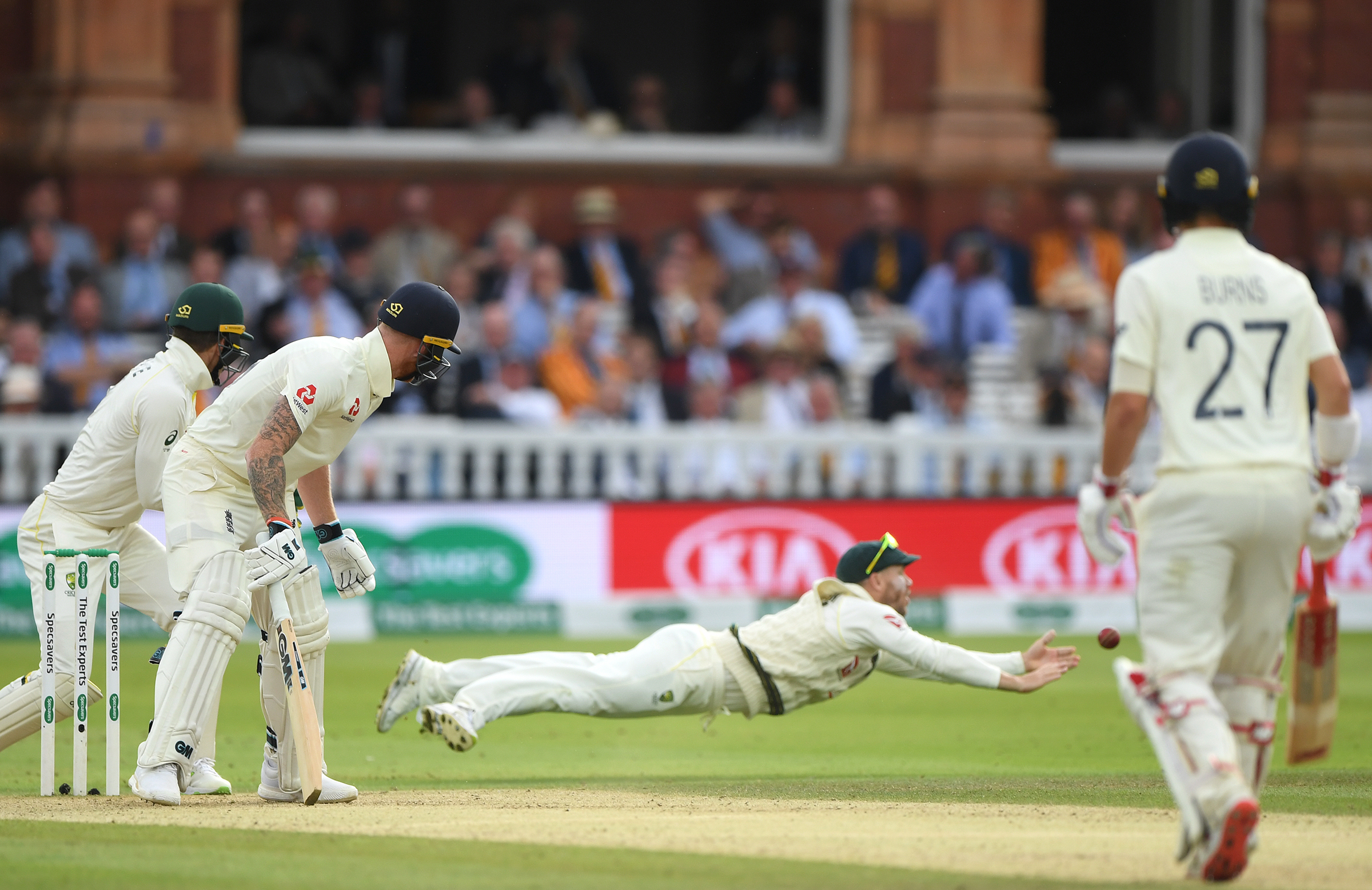 Warner fails to grasp a diving chance off Stokes // Getty