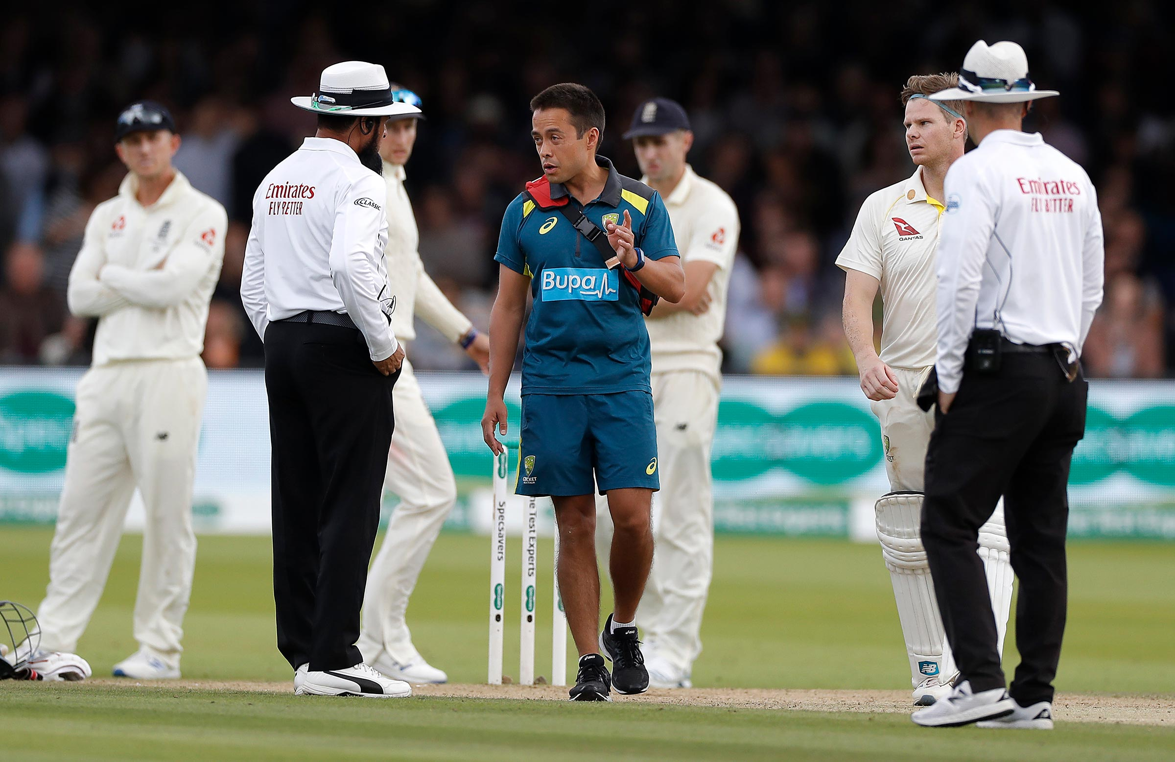 Dr Saw speaks to umpires at Lord's on Saturday // Getty