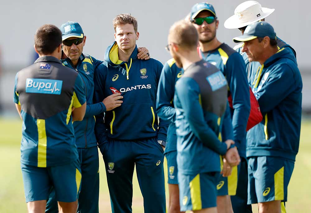 Smith is consoled by Langer and the support staff // Getty