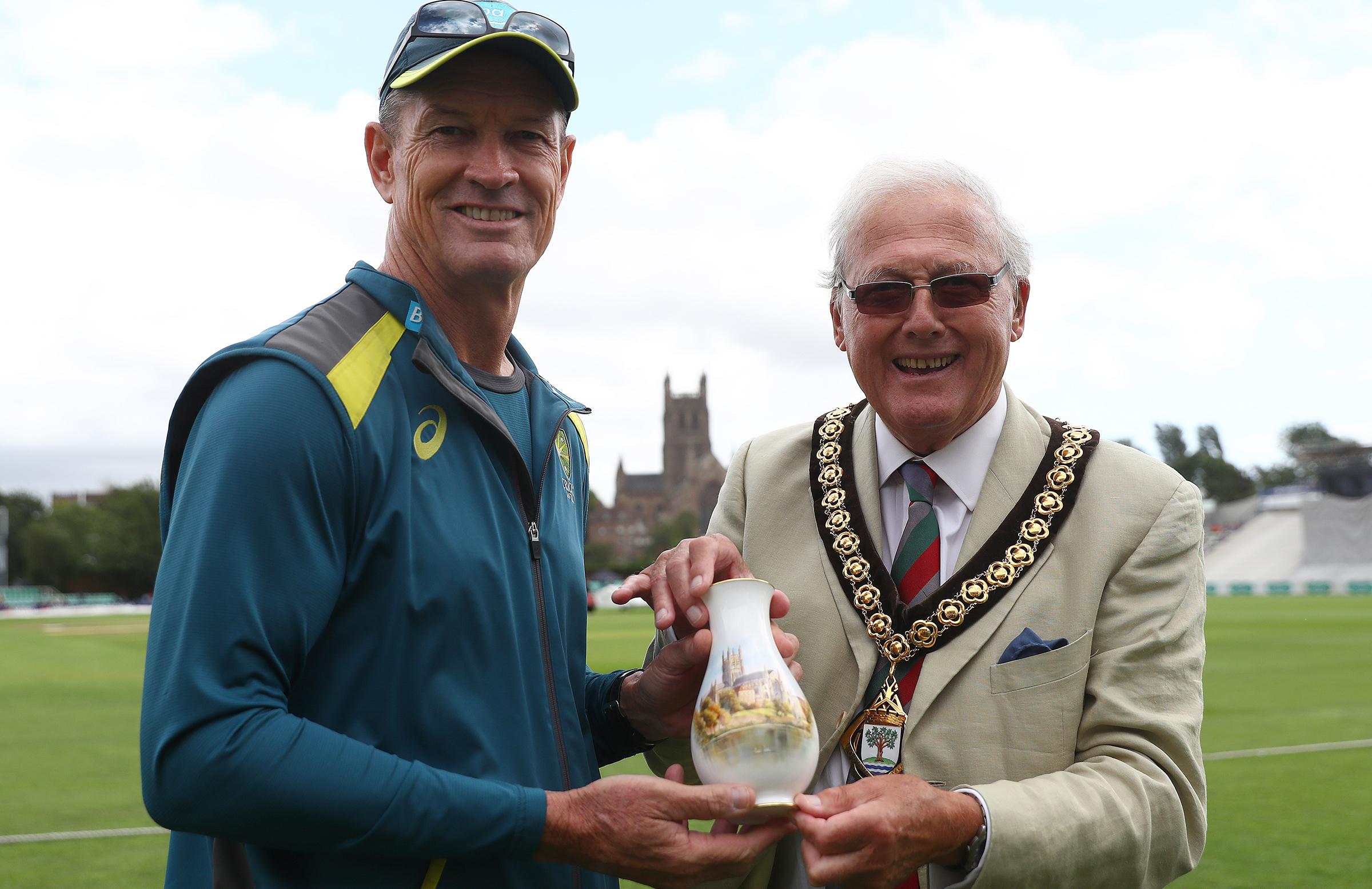 Graeme Hick accepts the porcelain vase commemorating Sir Donald Bradman // Getty