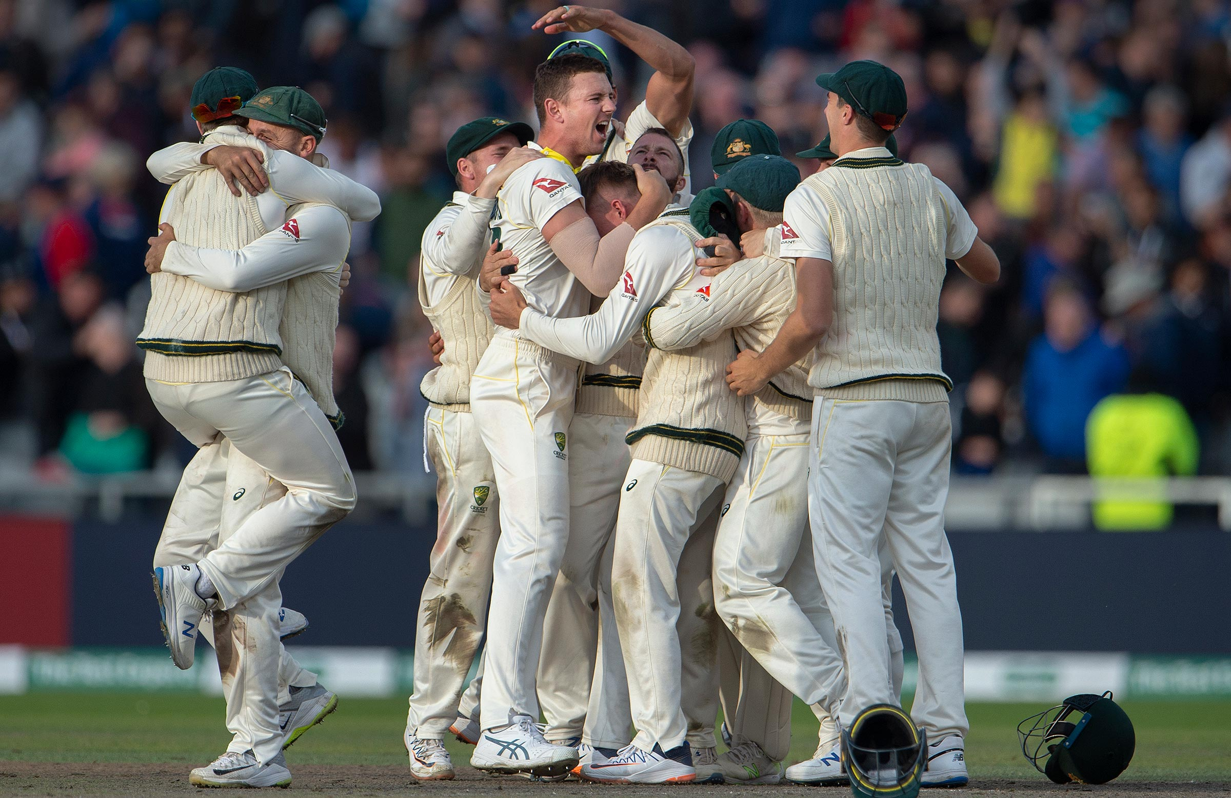 Australia's players embrace after the final wicket at Headingley // Getty