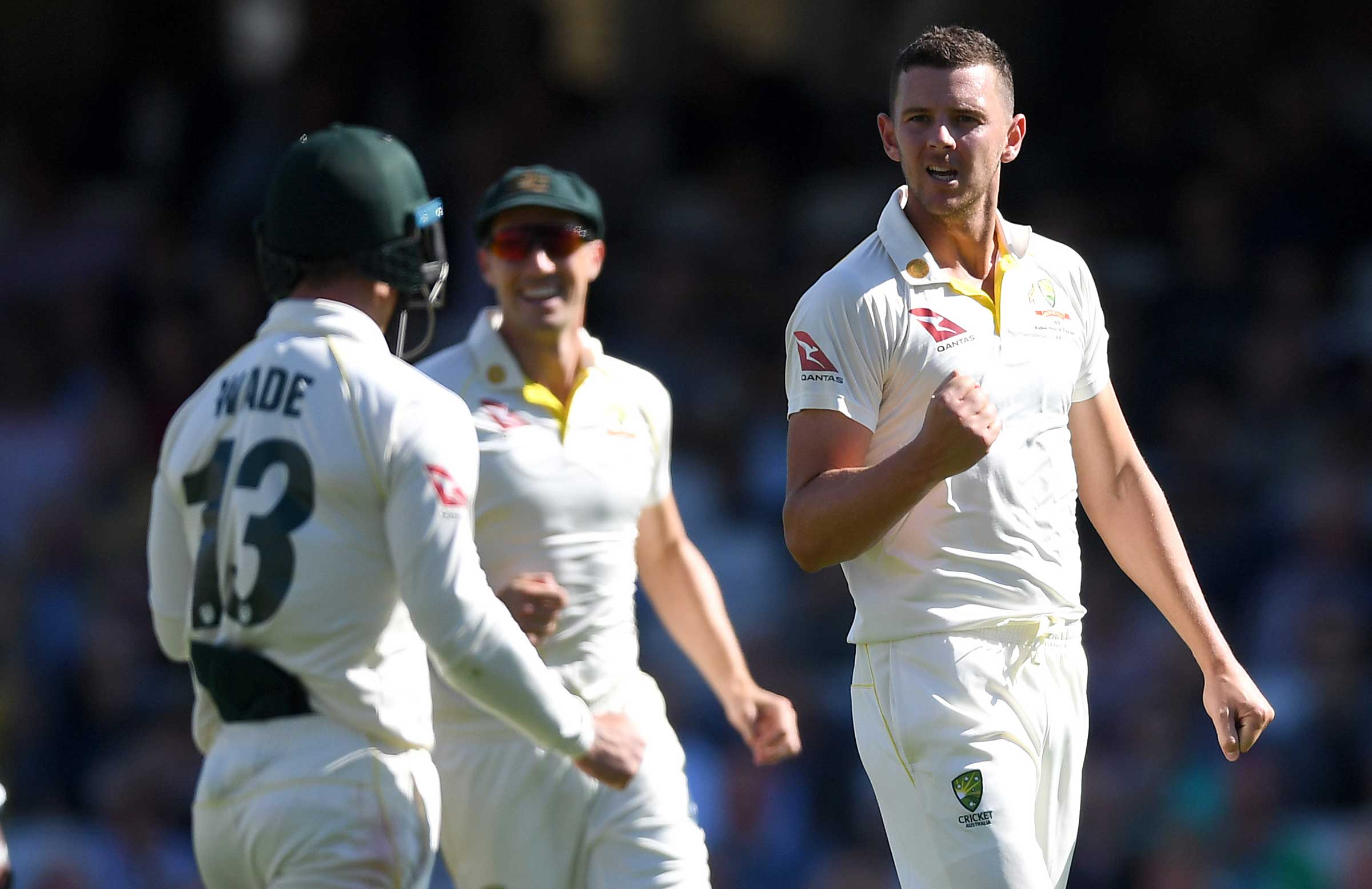 Hazlewood celebrates dismissing Burns // Getty