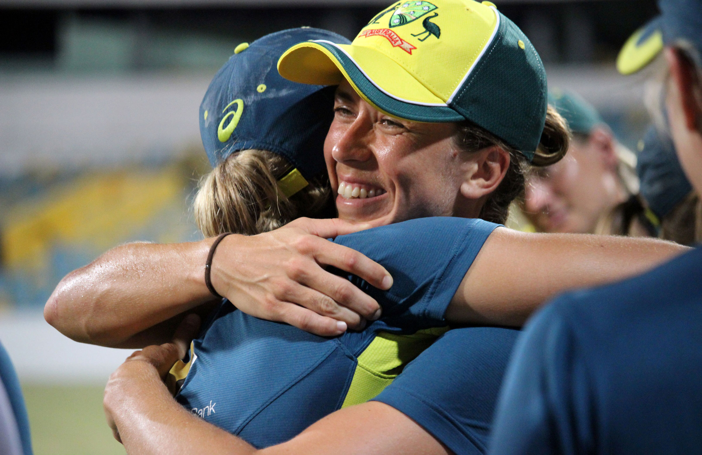 Erin Burns is congratulated by a teammate // Cricket Network