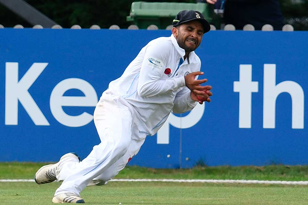 Hamidullah Qadri takes the catch to dismiss Smith // Getty